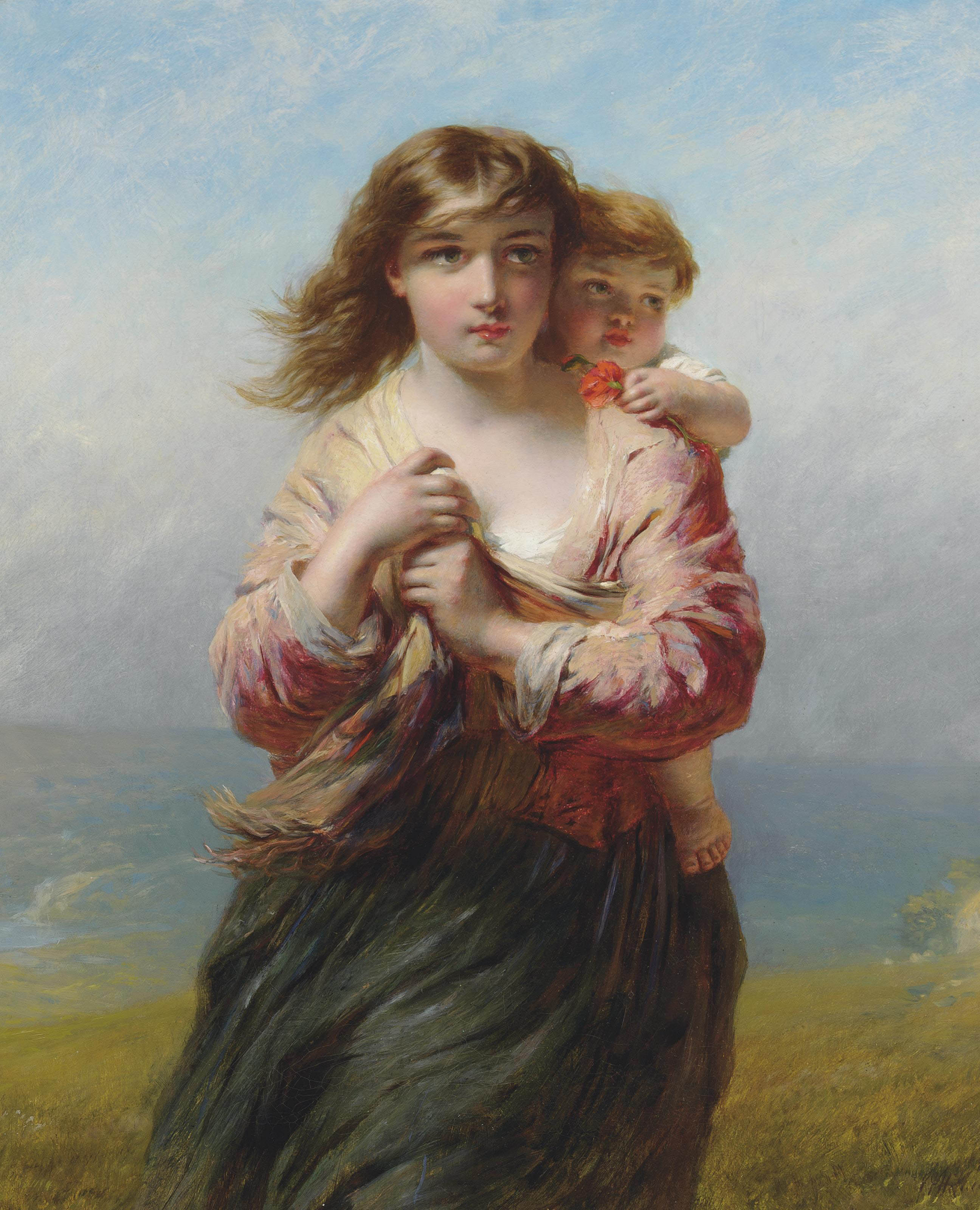 Mother and child on a hillside overlooking the sea