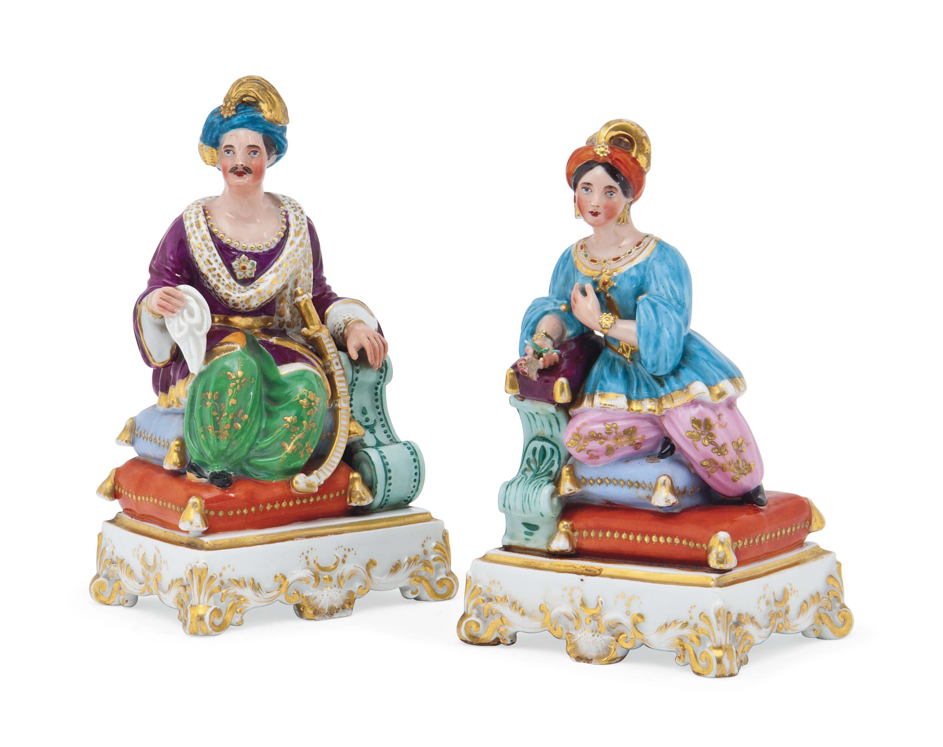 A PAIR OF FRENCH PORCELAIN FIGURAL FLASKS AND STOPPERS