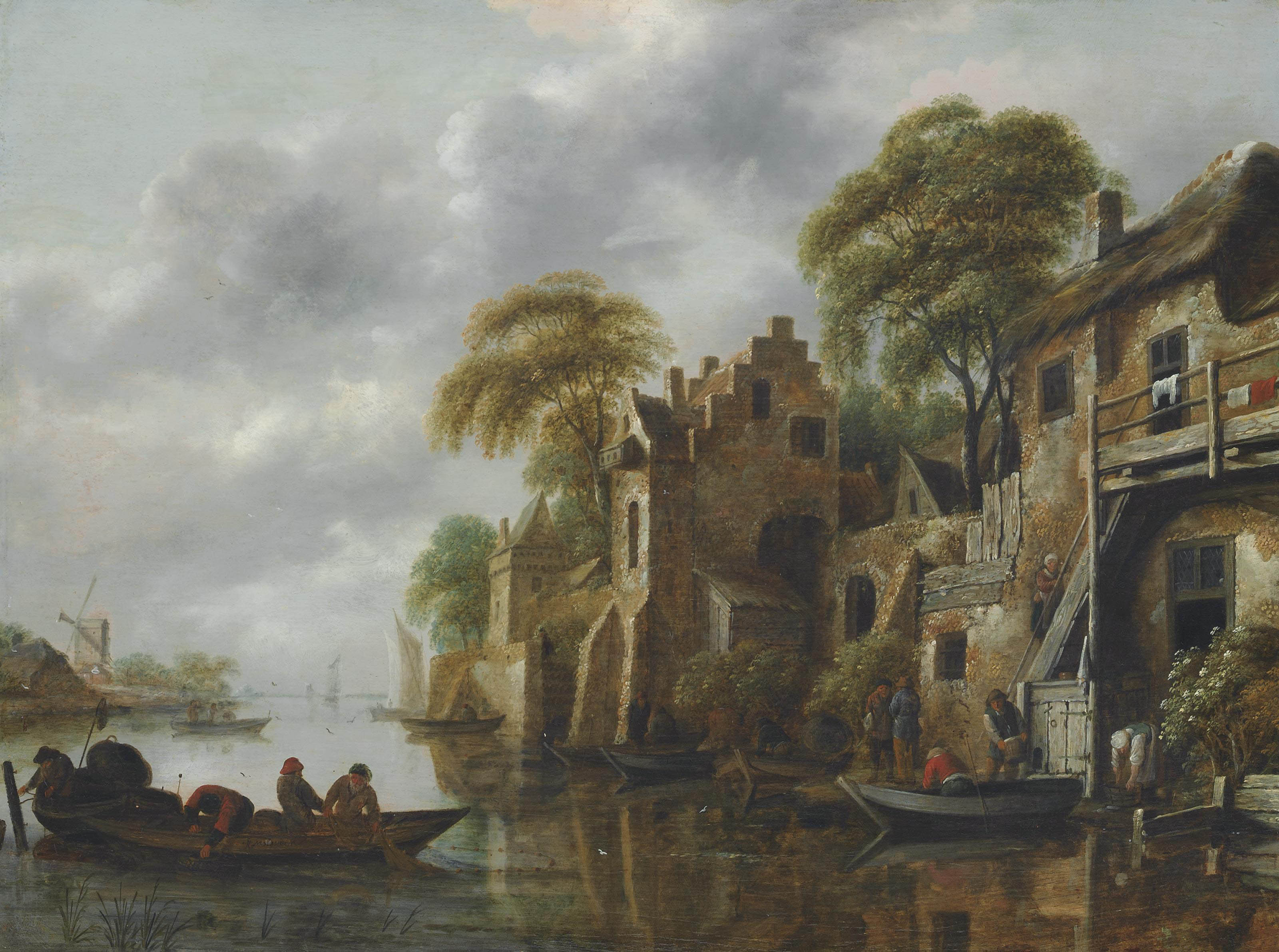 A river landscape with fishermen loading their nets, beside a town