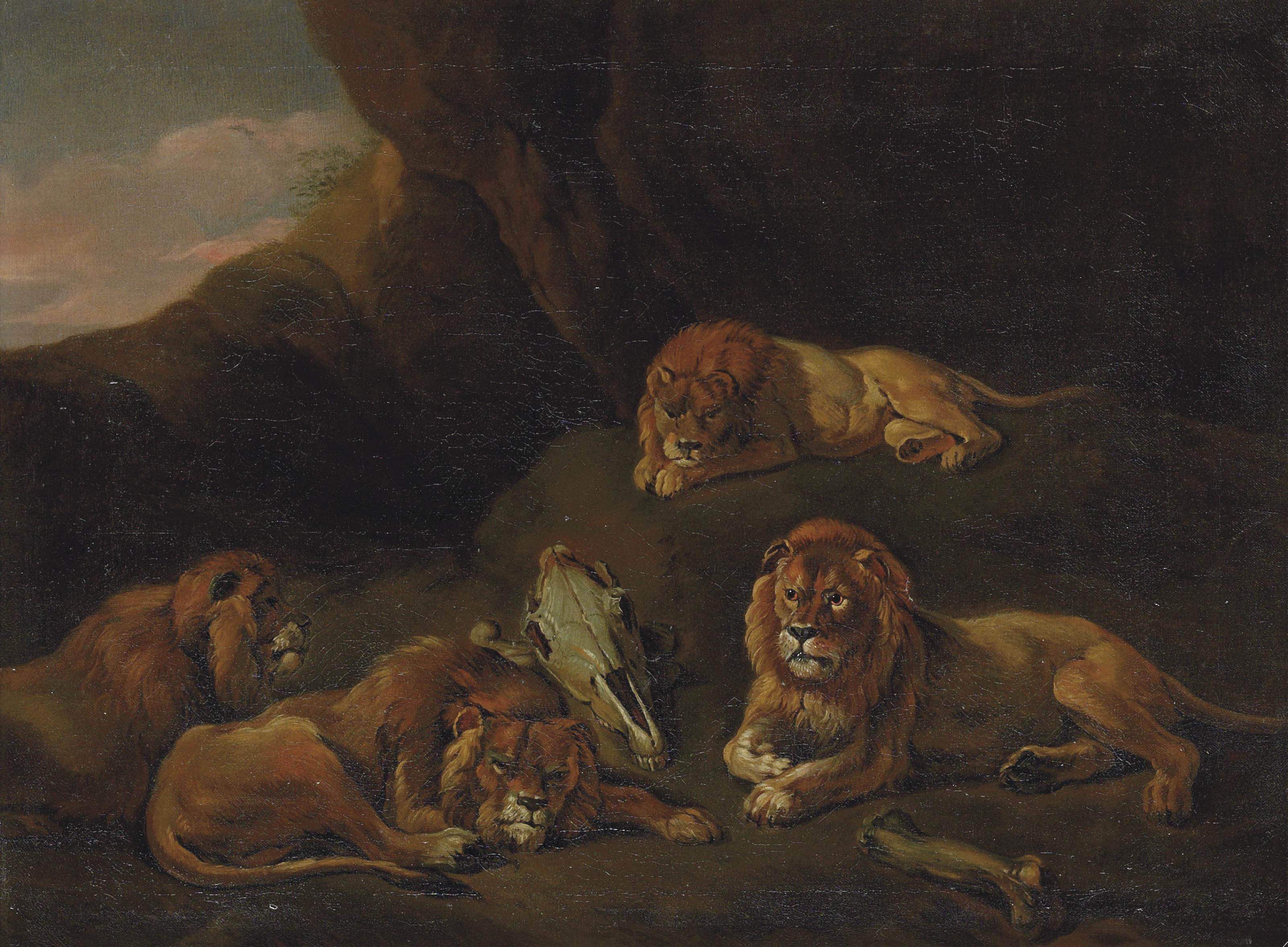 Lions resting in a rocky landscape