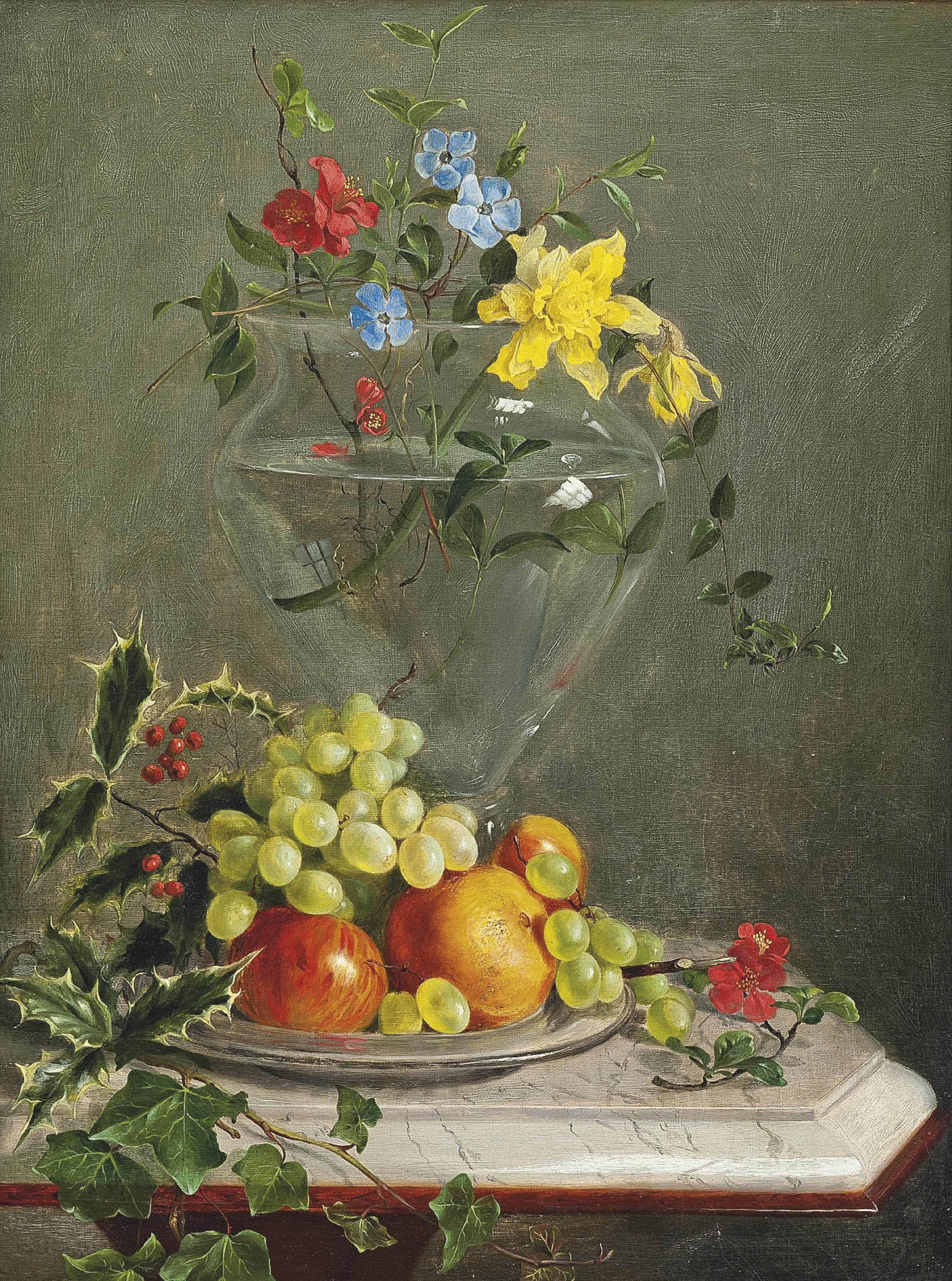 Holly, ivy, grapes, apples and oranges in a bowl by a vase of flowers including daffodils and phlox, on a marble ledge