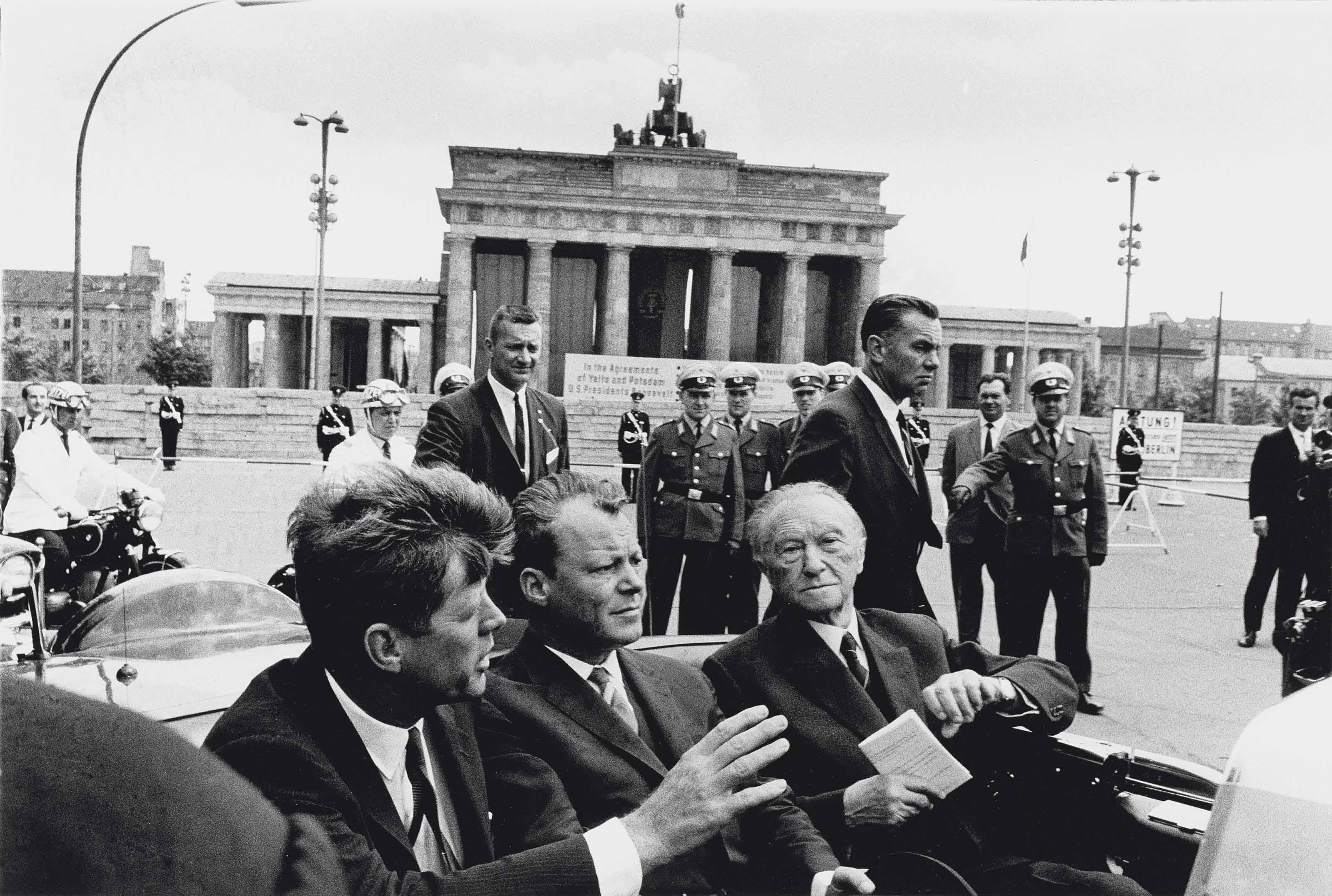 John F. Kennedy, Willy Brandt and Konrad Andenauer just leaving the Brandenburg Gate, Berlin, 1963