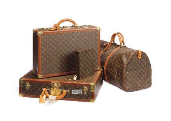 A GROUP OF LUGGAGE IN MONOGRAM