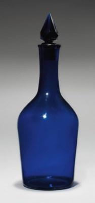 A BLUE-GLASS CLUB-SHAPED DECAN