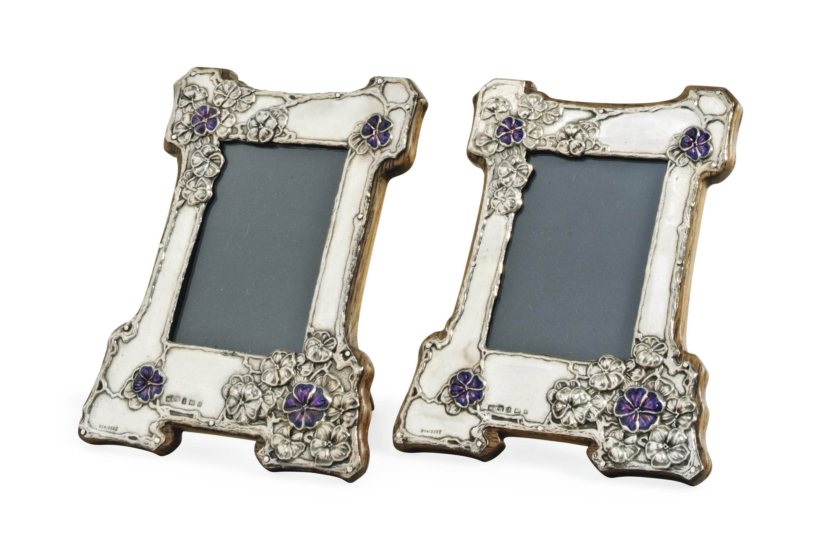 A PAIR OF W.H. HASLER SILVER AND ENAMEL PICTURE FRAMES