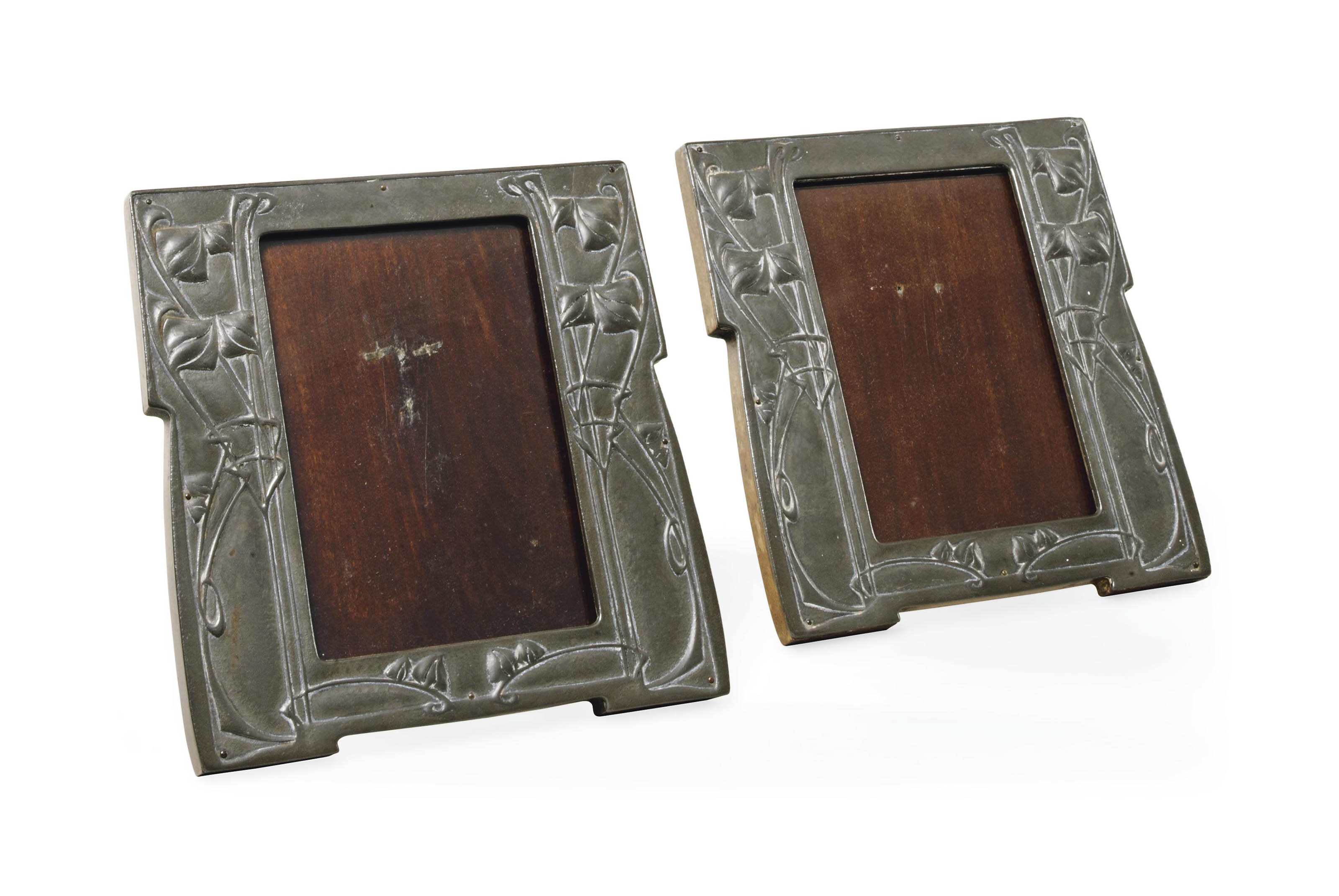 A PAIR OF ARCHIBALD KNOX FOR LIBERTY & CO PATINATED PEWTER PICTURE FRAMES