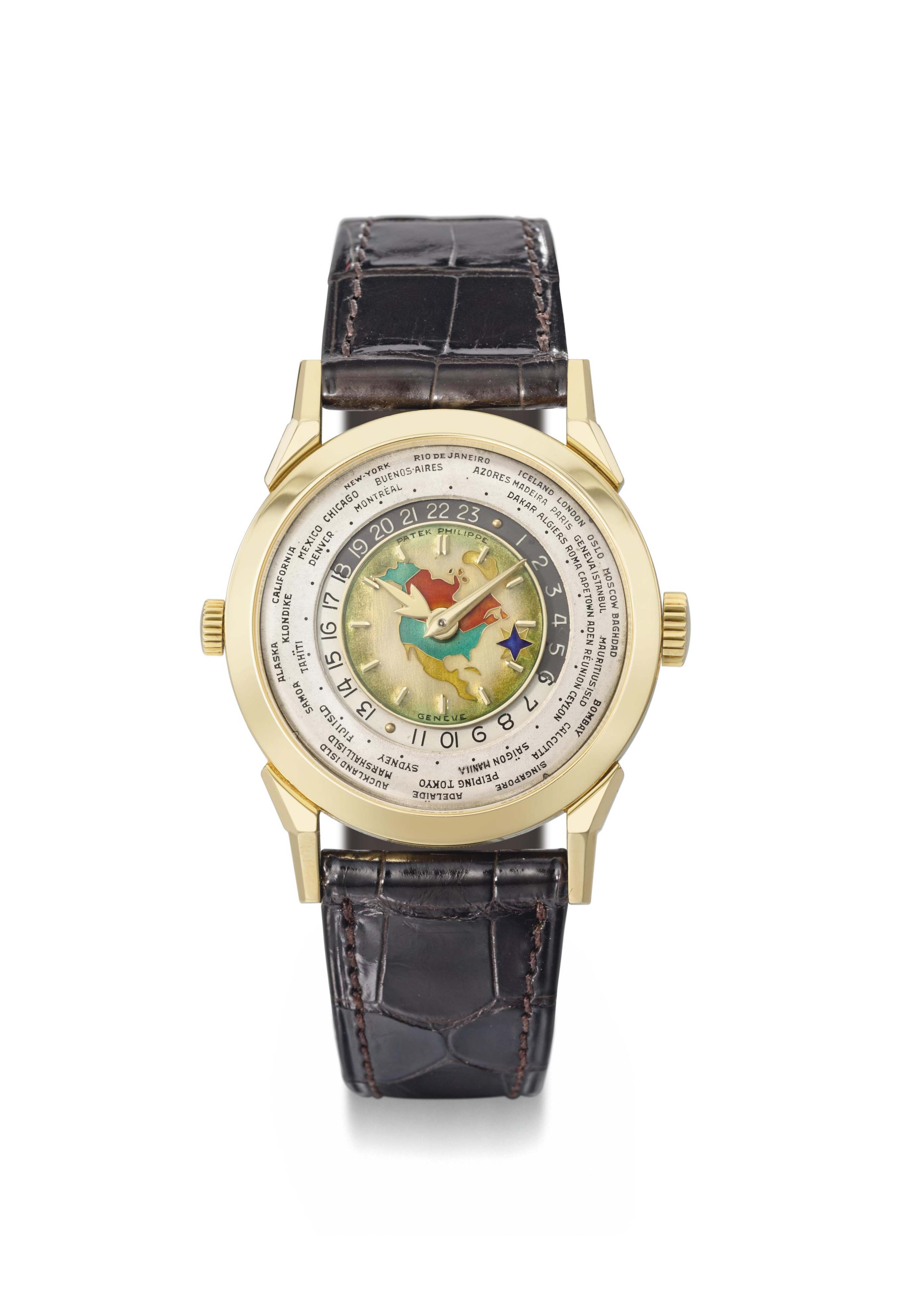 Patek Philippe. An exceptionally fine, rare and important 18K gold two crown world time wristwatch with 24 hour indication and cloisonné enamel dial depicting the North American continent