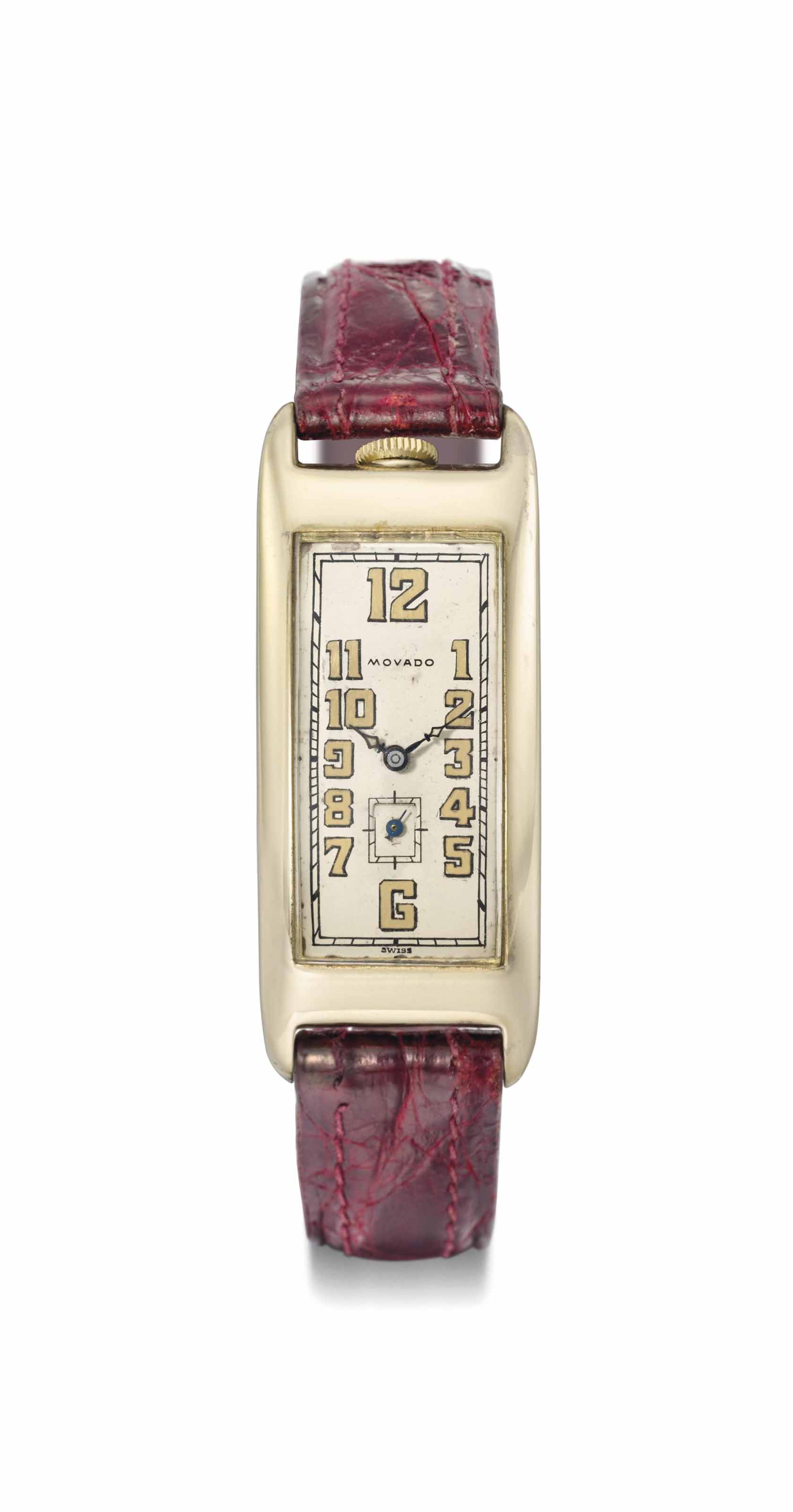 Movado. An early and unusual large 14K gold rectangular curved hinged wristwatch
