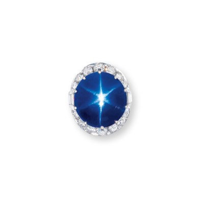 A STAR SAPPHIRE AND DIAMOND RI