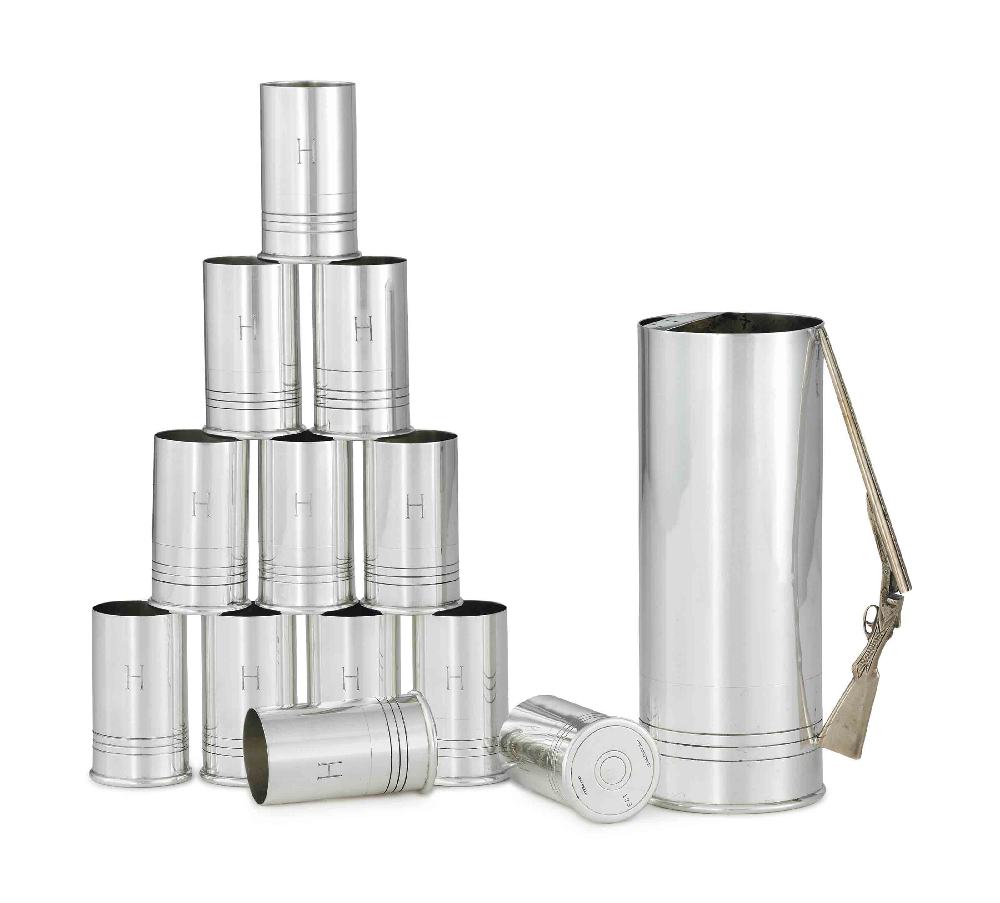 A SILVER MARTINI PITCHER AND TWELVE SHOT GLASSES