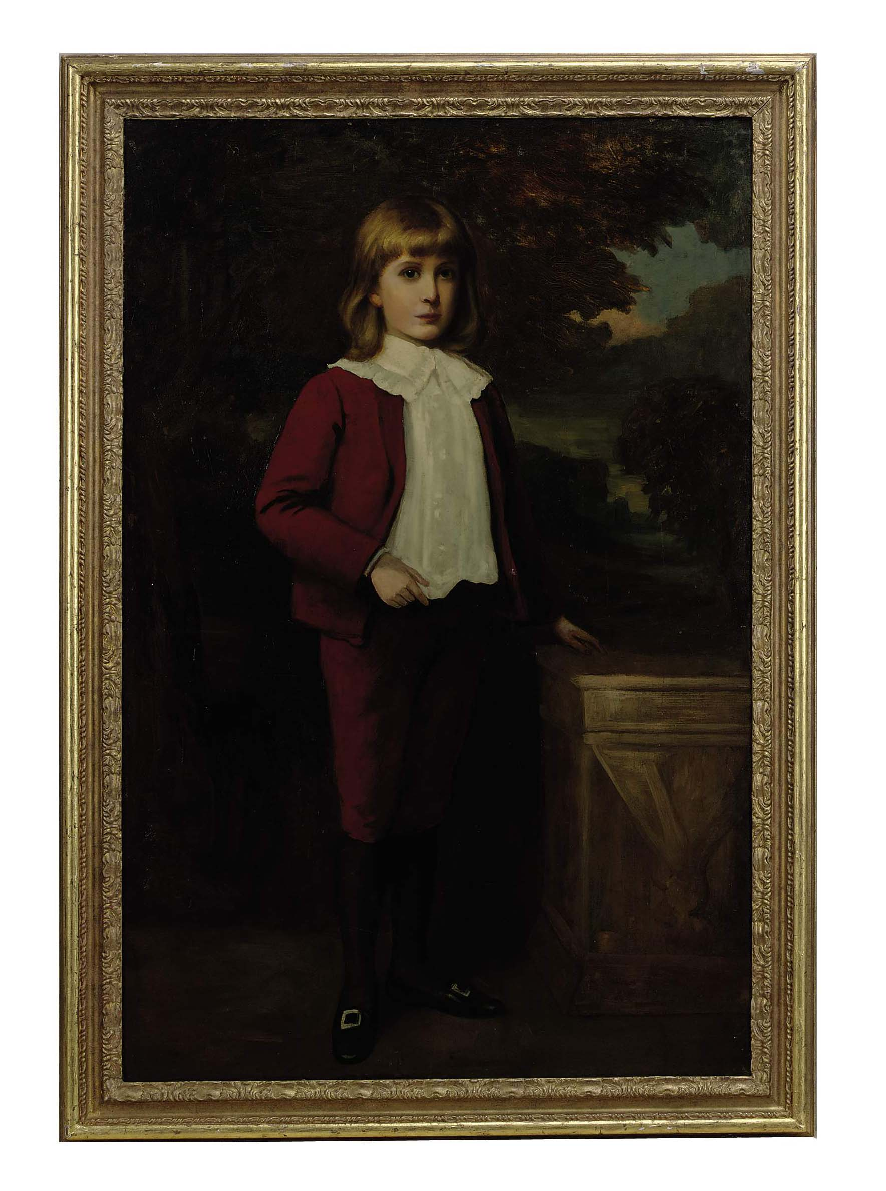 Portrait of a young boy wearing a red suit