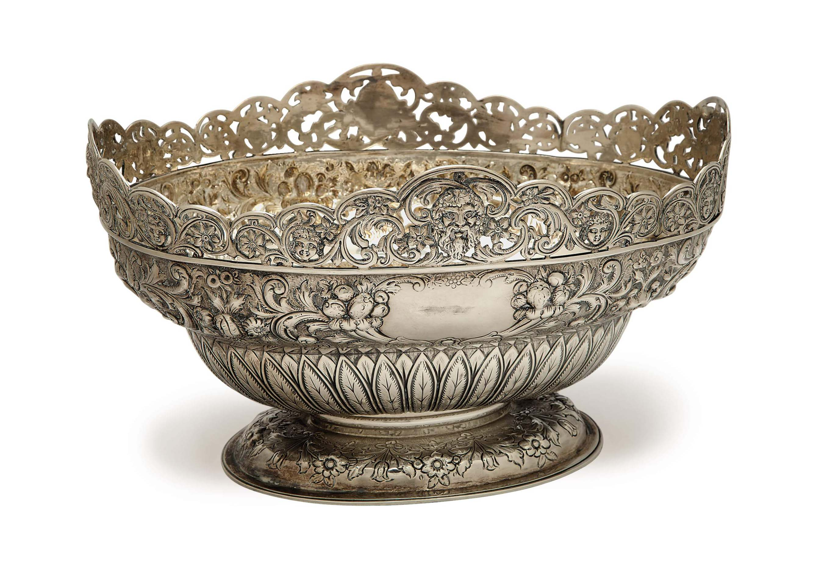 A REGENCY SILVER REPOUSSE RETICULATED OVAL CENTERBOWL,