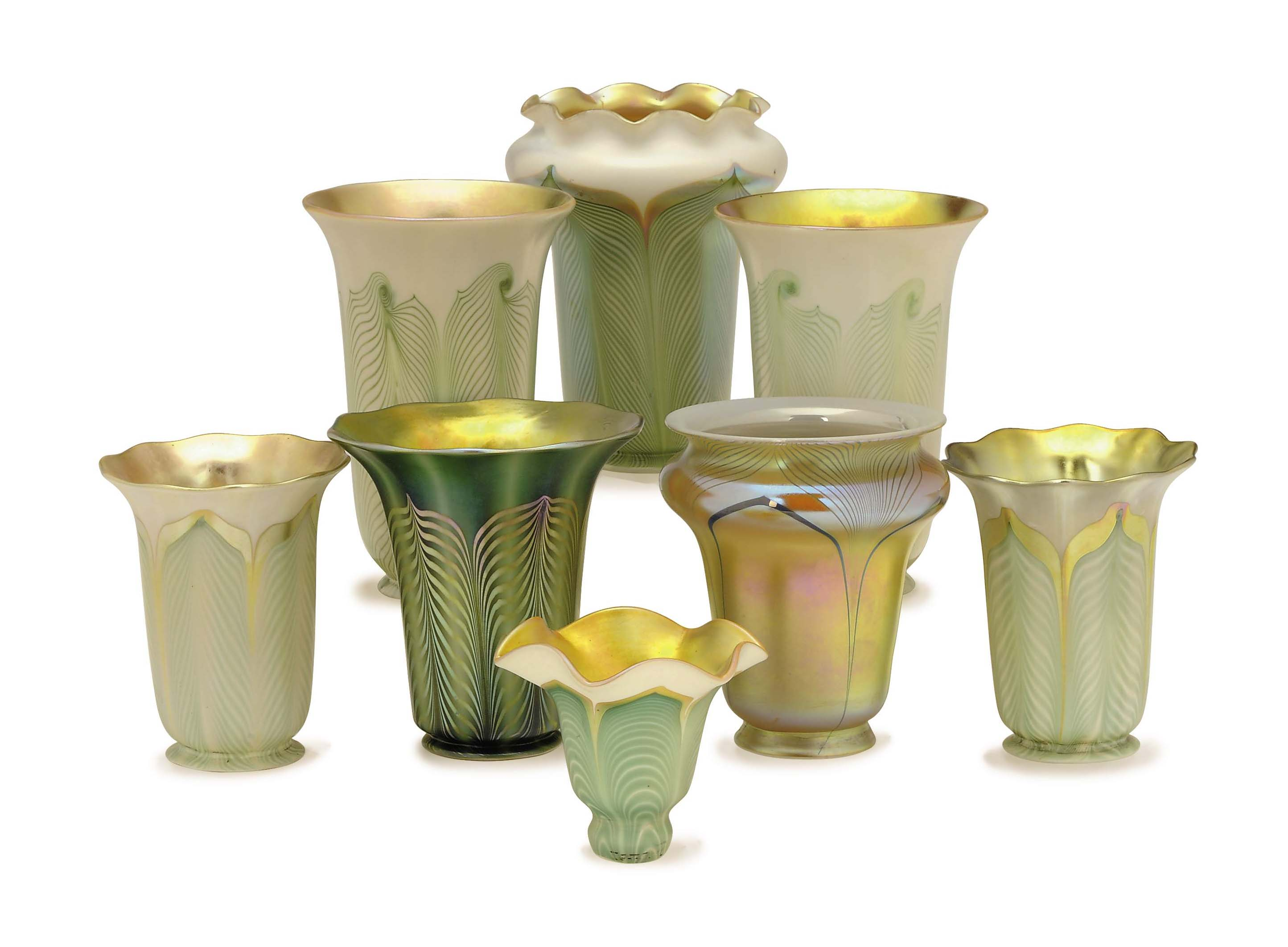 FOUR AMERICAN IRIDESCENT FEATHERED GLASS SHADES, AND FOUR SIMILAR SHADES,