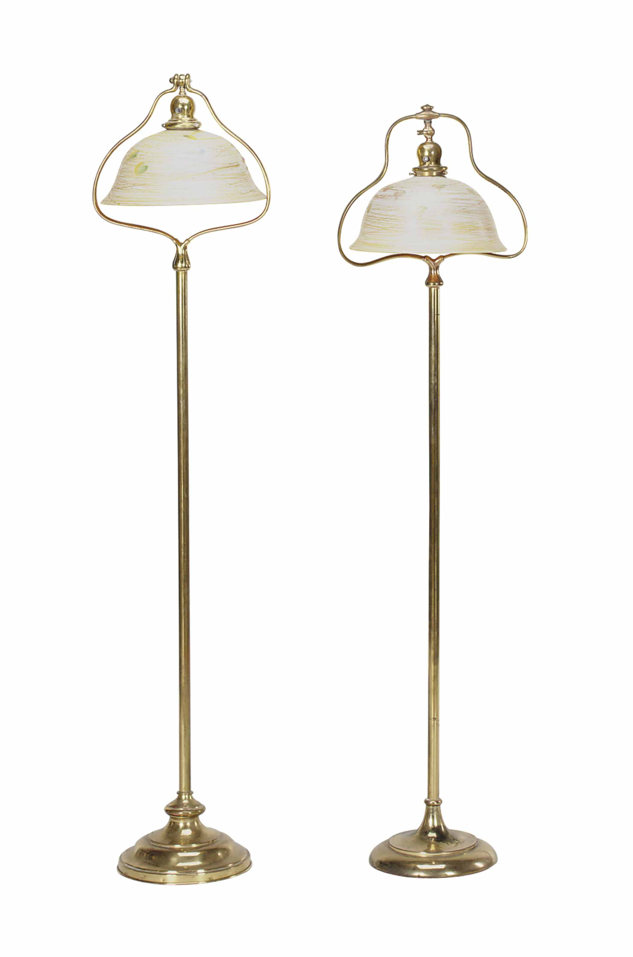 A PAIR OF GILT-BRASS FLOOR LAMPS WITH IRRIDESCENT GLASS SHADES,