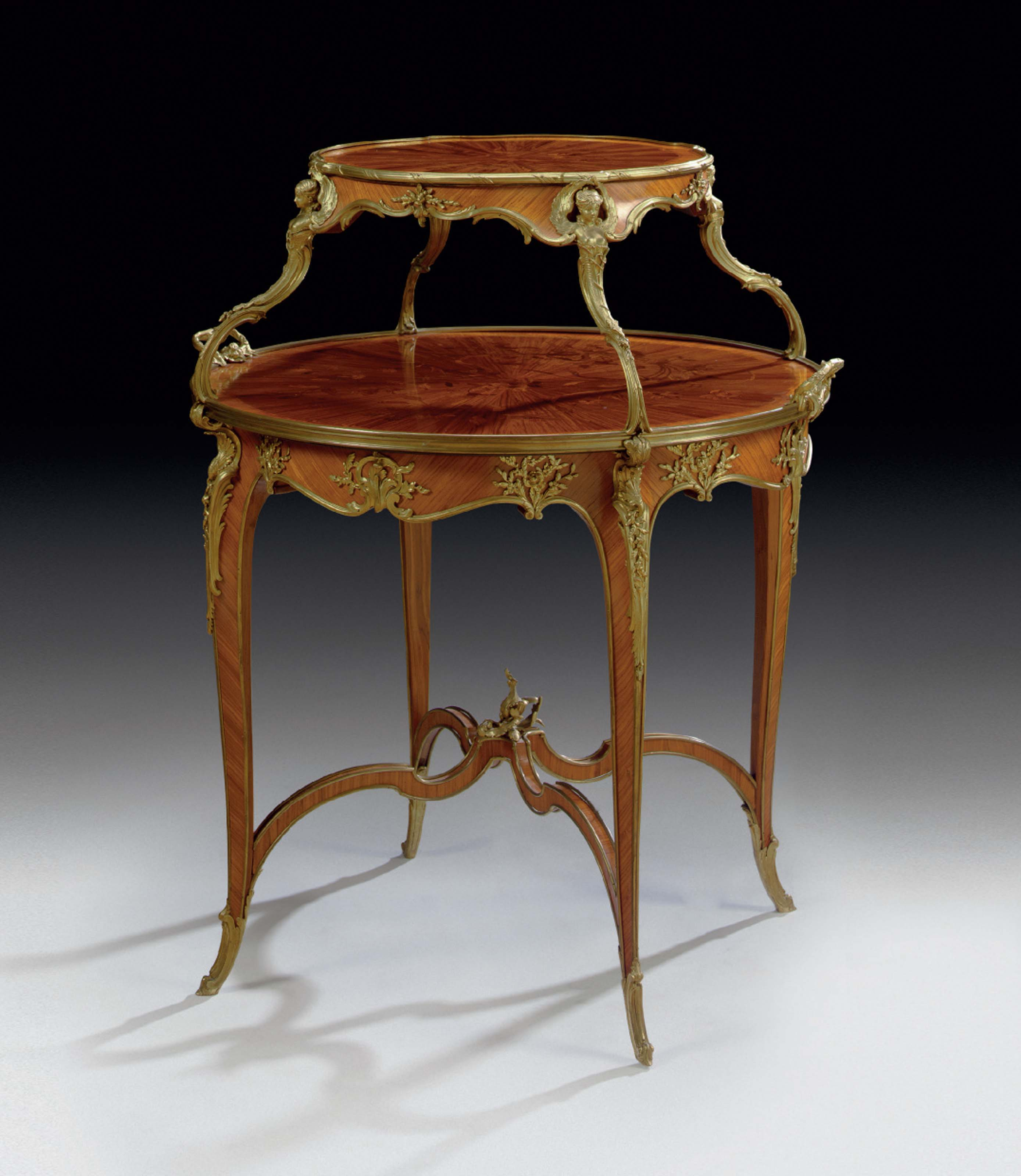 A FRENCH ORMOLU-MOUNTED KINGWOOD, SATINE AND BOIS DE BOUT MARQUETRY TEA-TABLE
