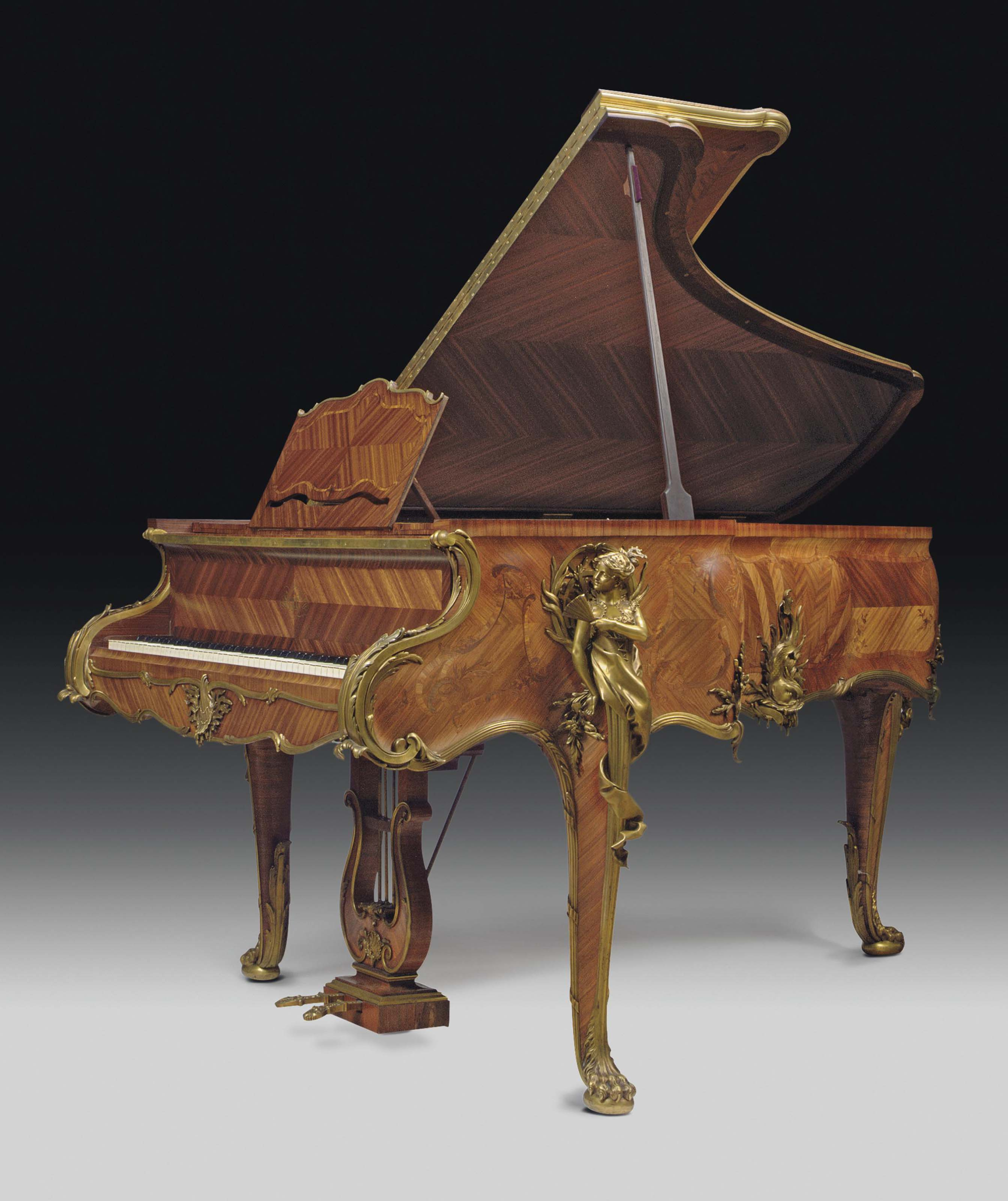 A HIGHLY IMPORTANT FRENCH ORMOLU-MOUNTED KINGWOOD AND SATINE MARQUETRY AND PARQUETRY PIANO A QUEUE
