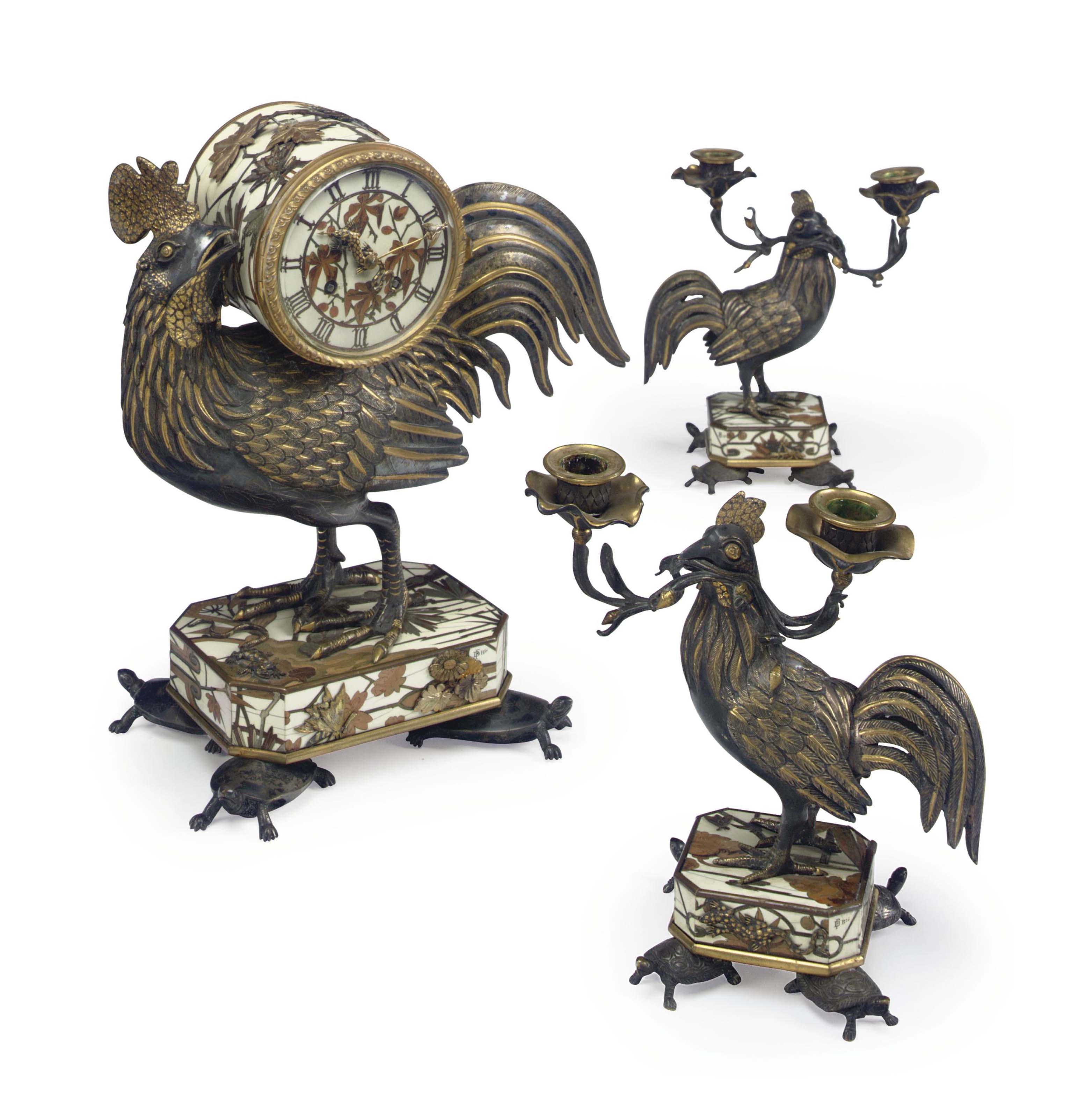 A FRENCH PARCEL-GILT AND SILVERED-BRONZE, IVORY, COPPER AND STAINED FRUITWOOD MARQUETRY THREE-PIECE CLOCK GARNITURE