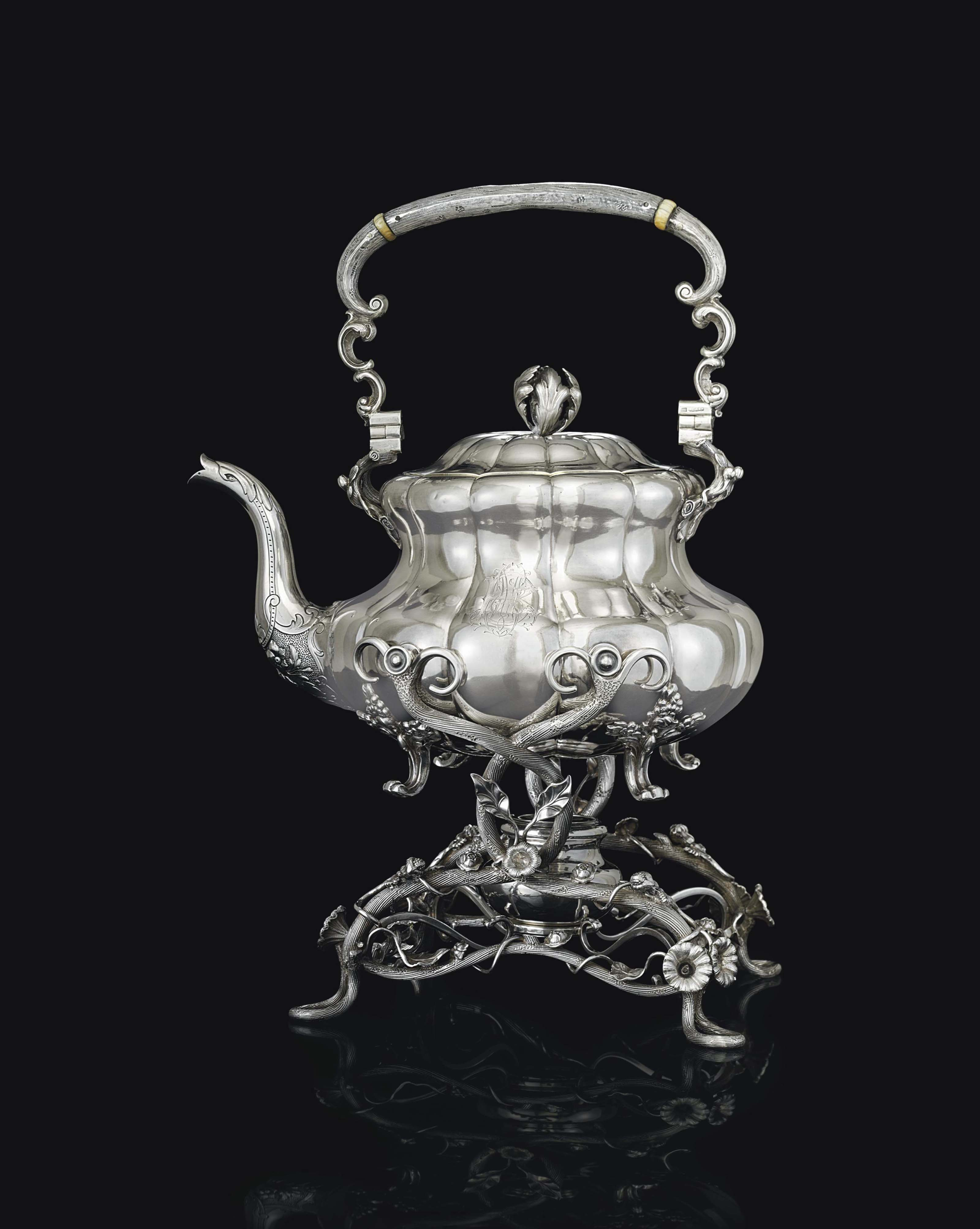 A SILVER TEA KETTLE-ON-STAND