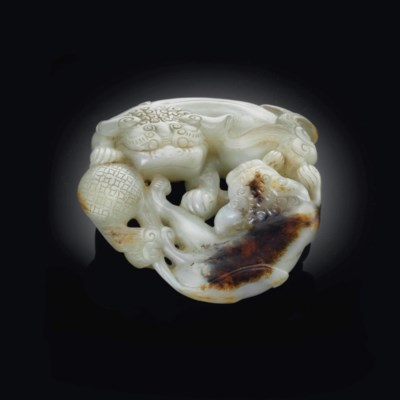 A WHITE AND BROWN JADE CARVING