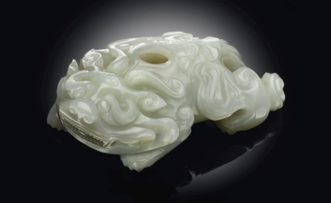 A GREENISH-WHITE JADE BIXI-FOR