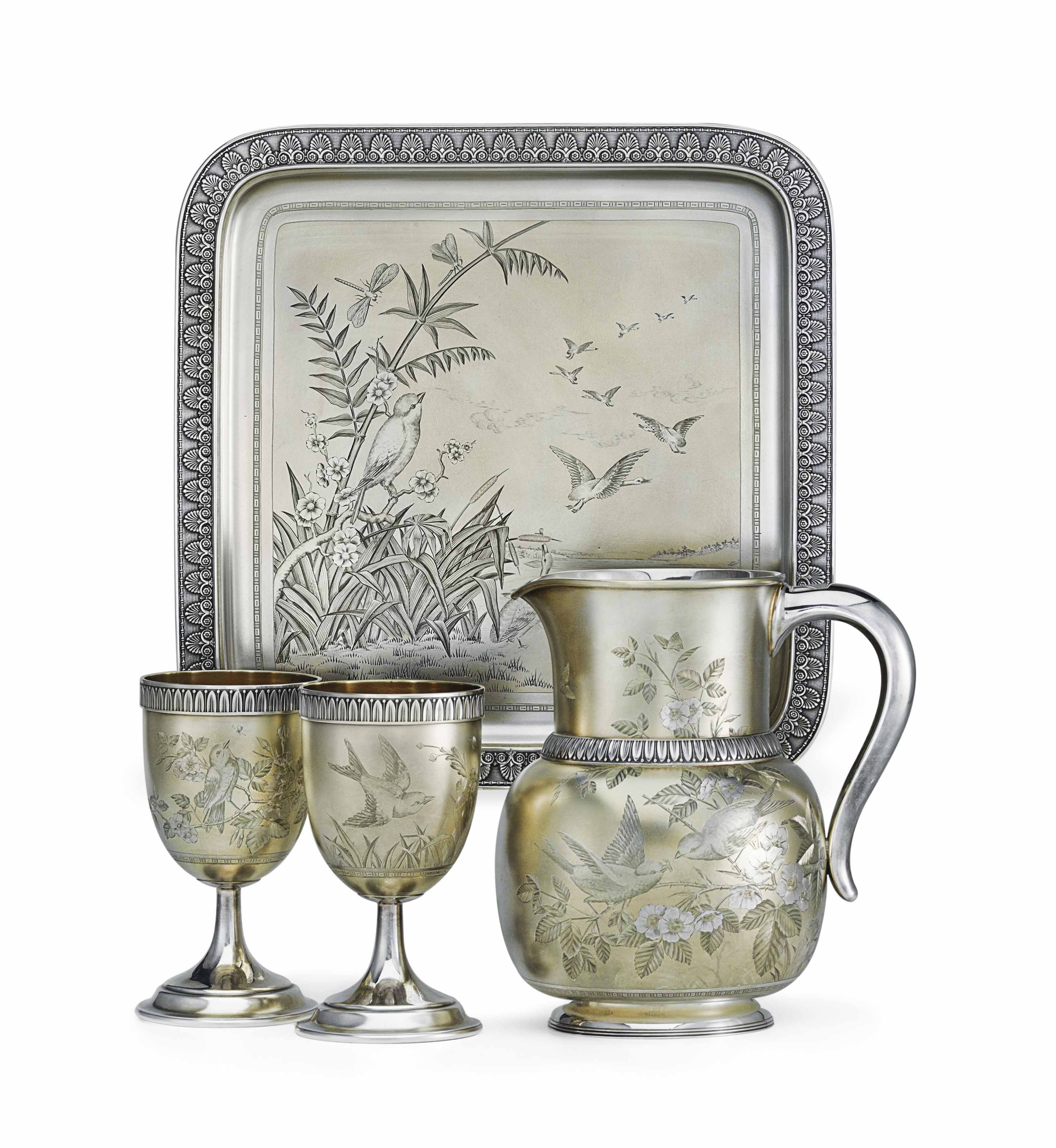 A FINE AMERICAN PARCEL-GILT AND ENGRAVED SILVER WATER SET