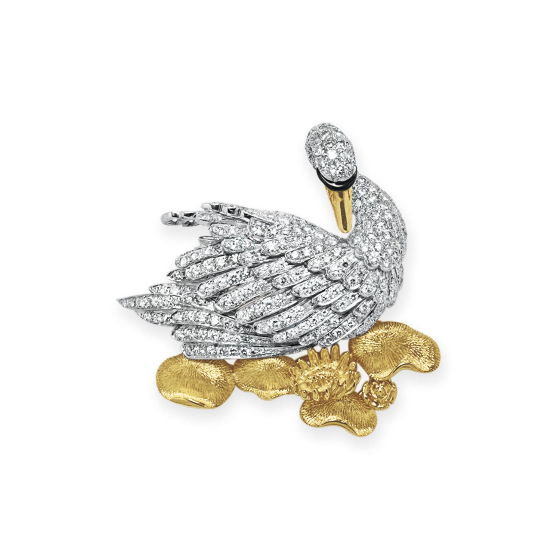 A DIAMOND AND GOLD BROOCH, BY MCTEIGUE & CO.