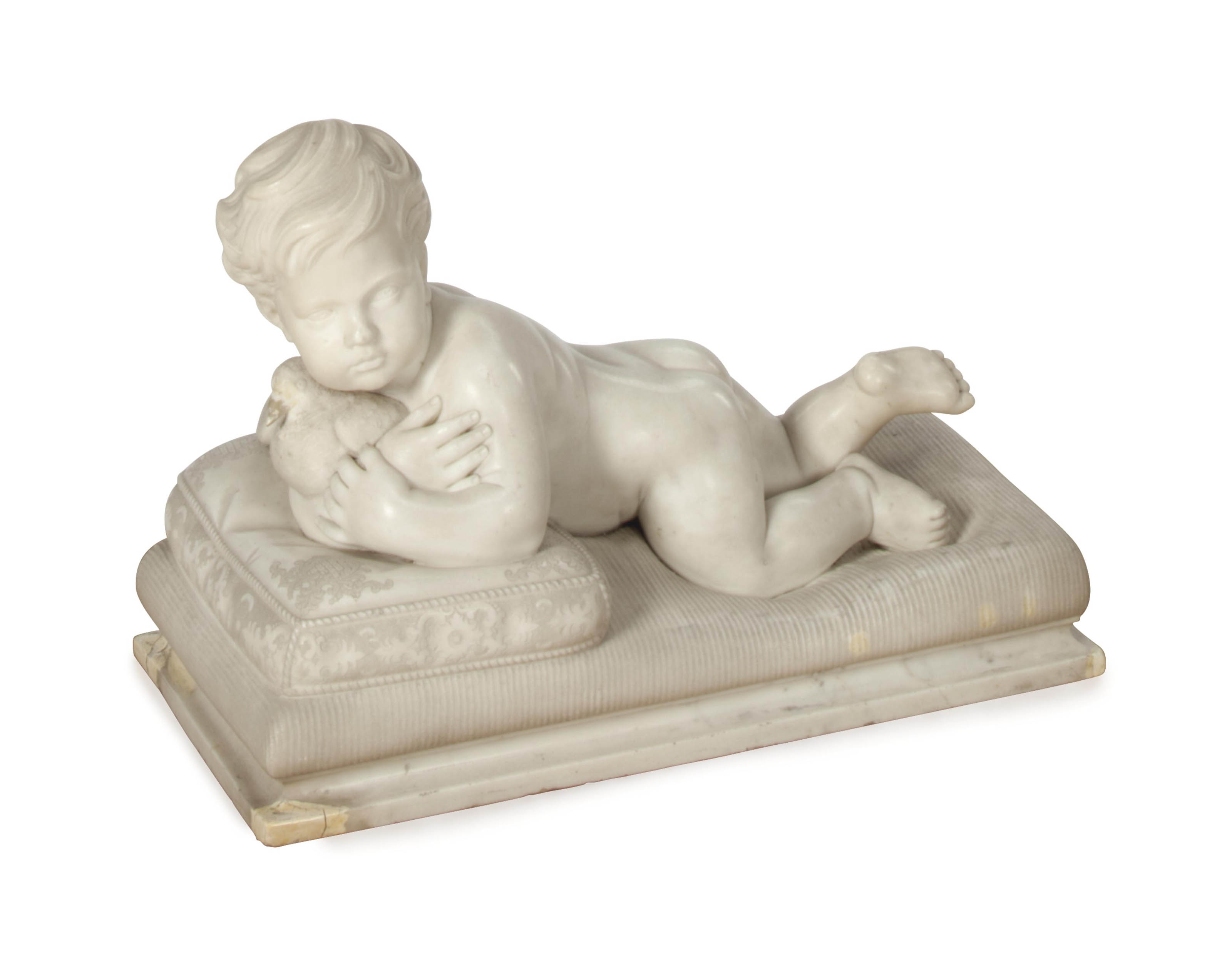 AN ITALIAN MARBLE FIGURAL GROUP OF A BOY WITH A DOVE ON A PILLOW,