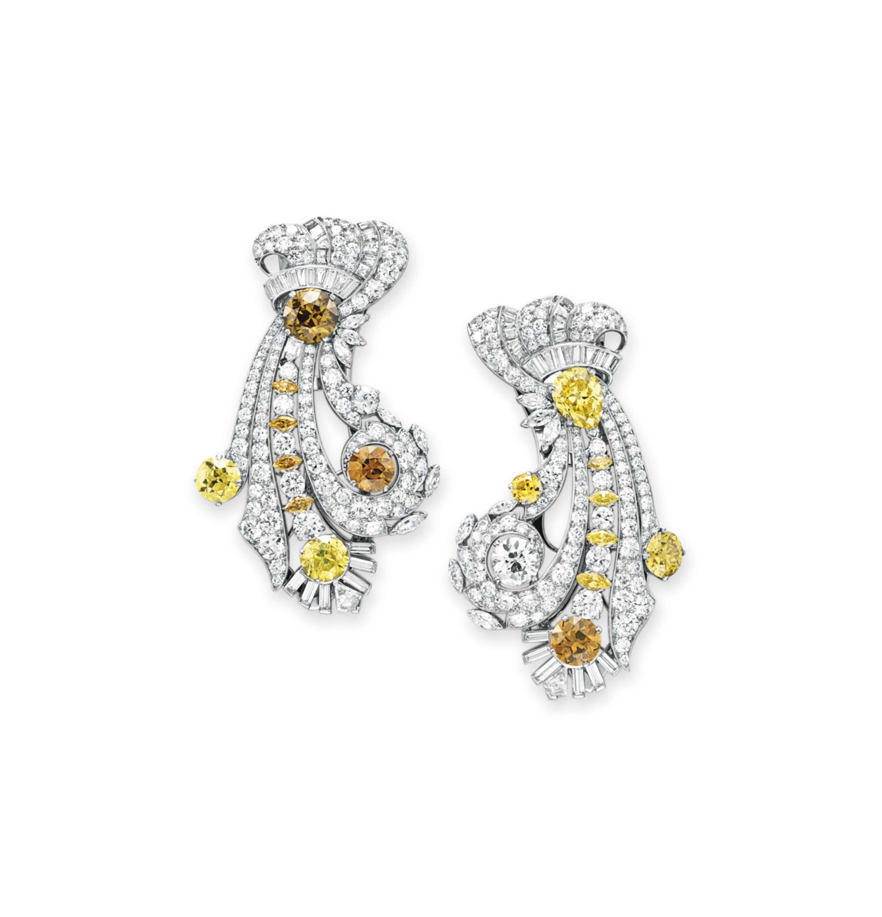 A PAIR OF DIAMOND AND COLORED DIAMOND CLIP BROOCHES, BY RAYMOND YARD