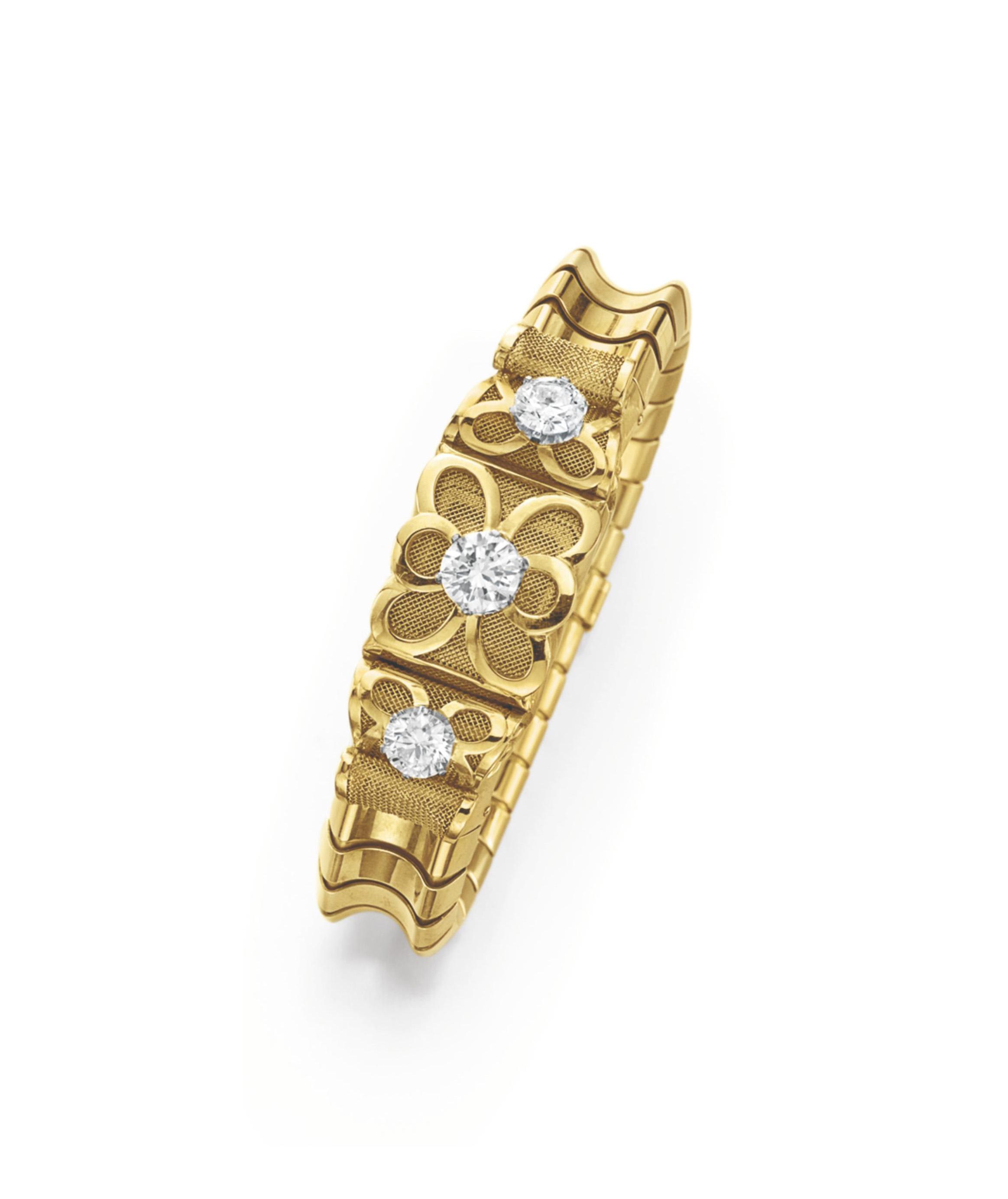 A DIAMOND AND GOLD BRACELET-WATCH, BY GÜBELIN