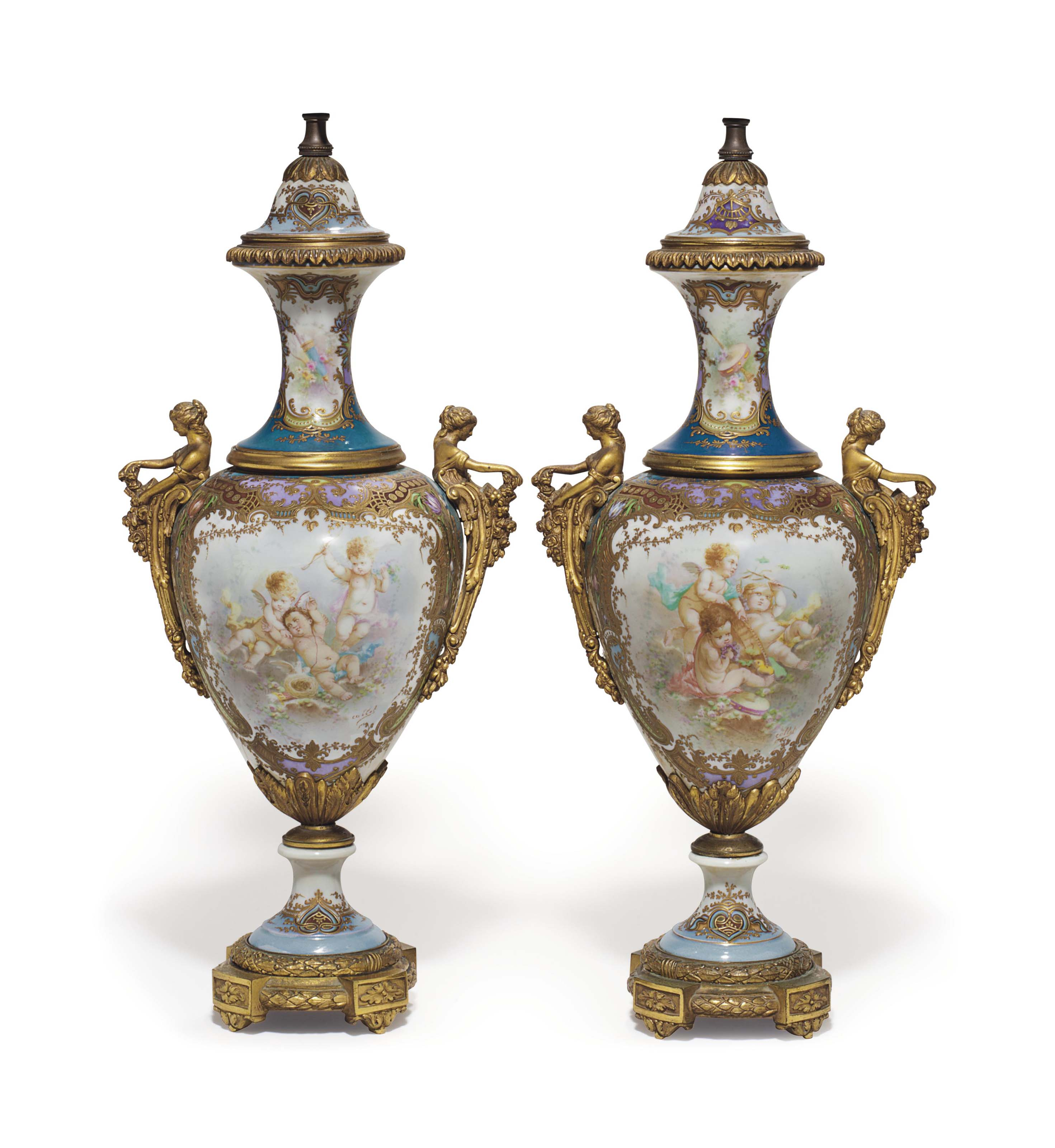 A PAIR OF ORMOLU-MOUNTED SEVRES STYLE PORCELAIN IRIDESCENT-POLYCHROME GROUND VASES AND COVERS