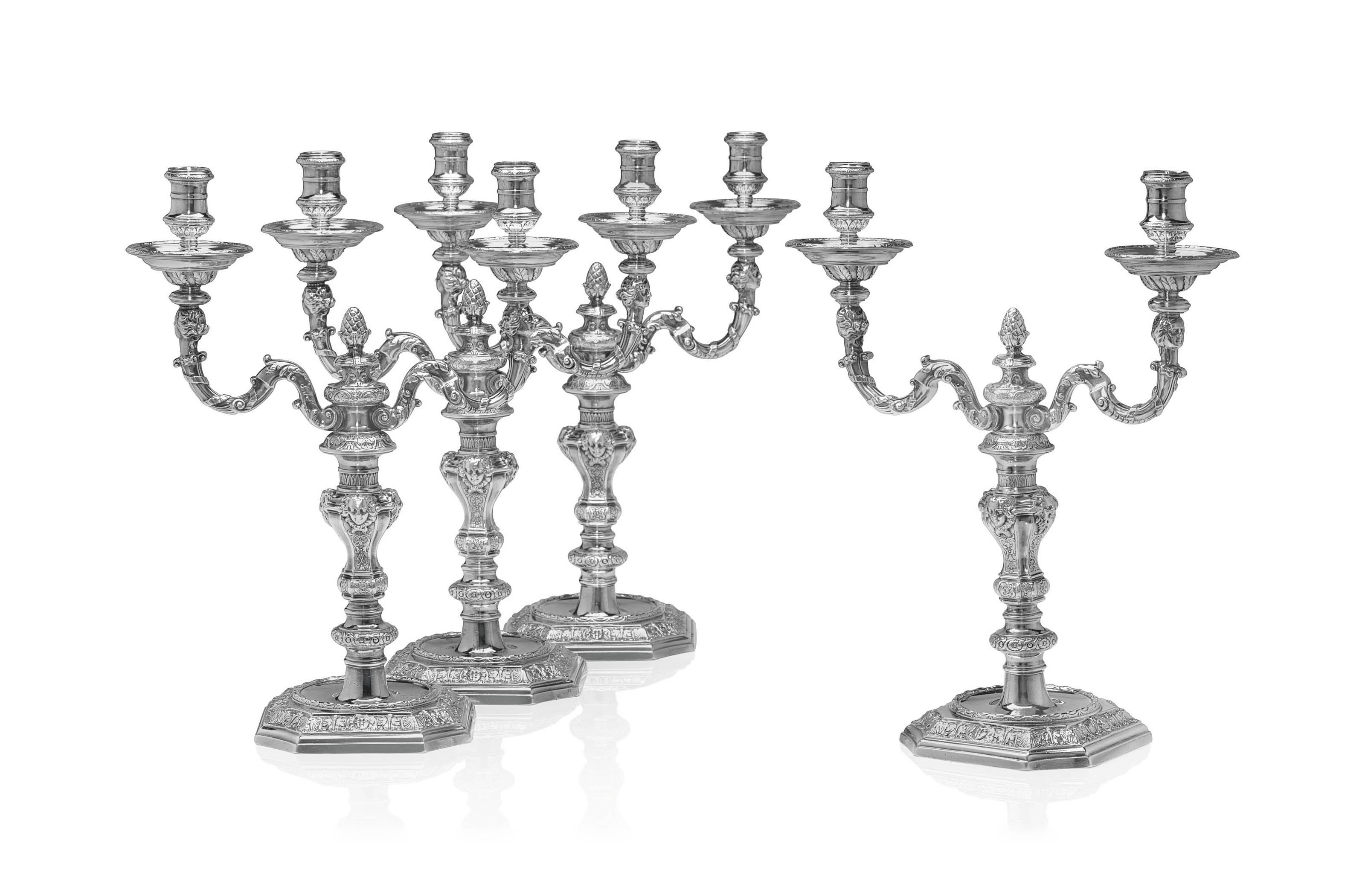 AN IMPORTANT SET OF FOUR GEORGE II SILVER TWO-LIGHT CANDELABRA