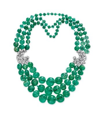 A THREE-STRAND EMERALD BEAD AN