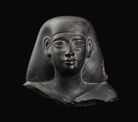 AN EGYPTIAN GRANITE BUST OF AN