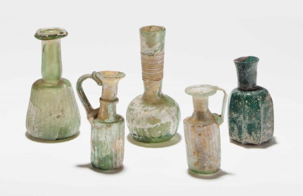 FIVE ANCIENT GLASS VESSELS