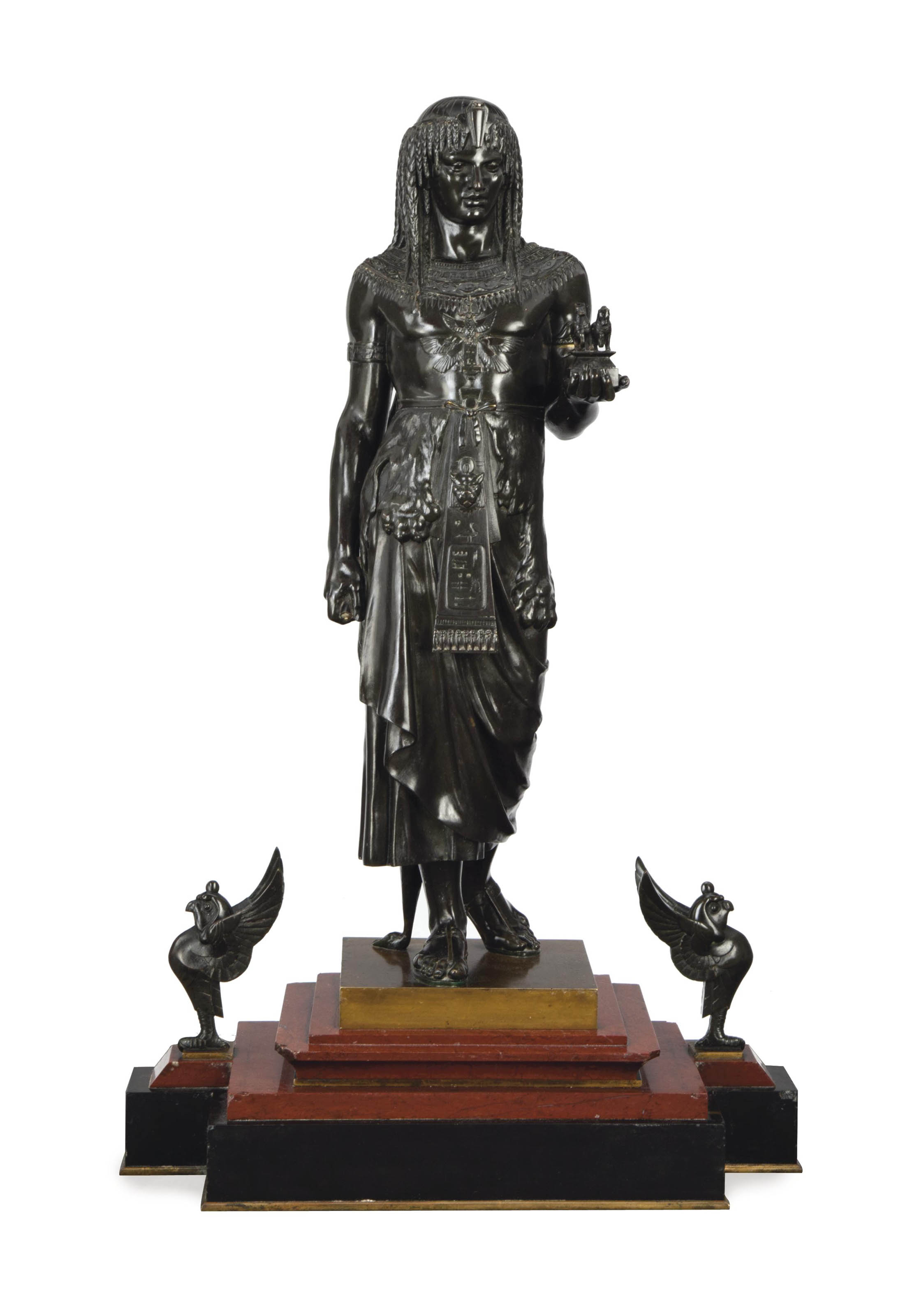 A FRENCH PATINATED-BRONZE FIGURE OF KING MENTHUOPHIS MOUNTED ON A ROUGE MARBLE AND BLACK SLATE BASE,