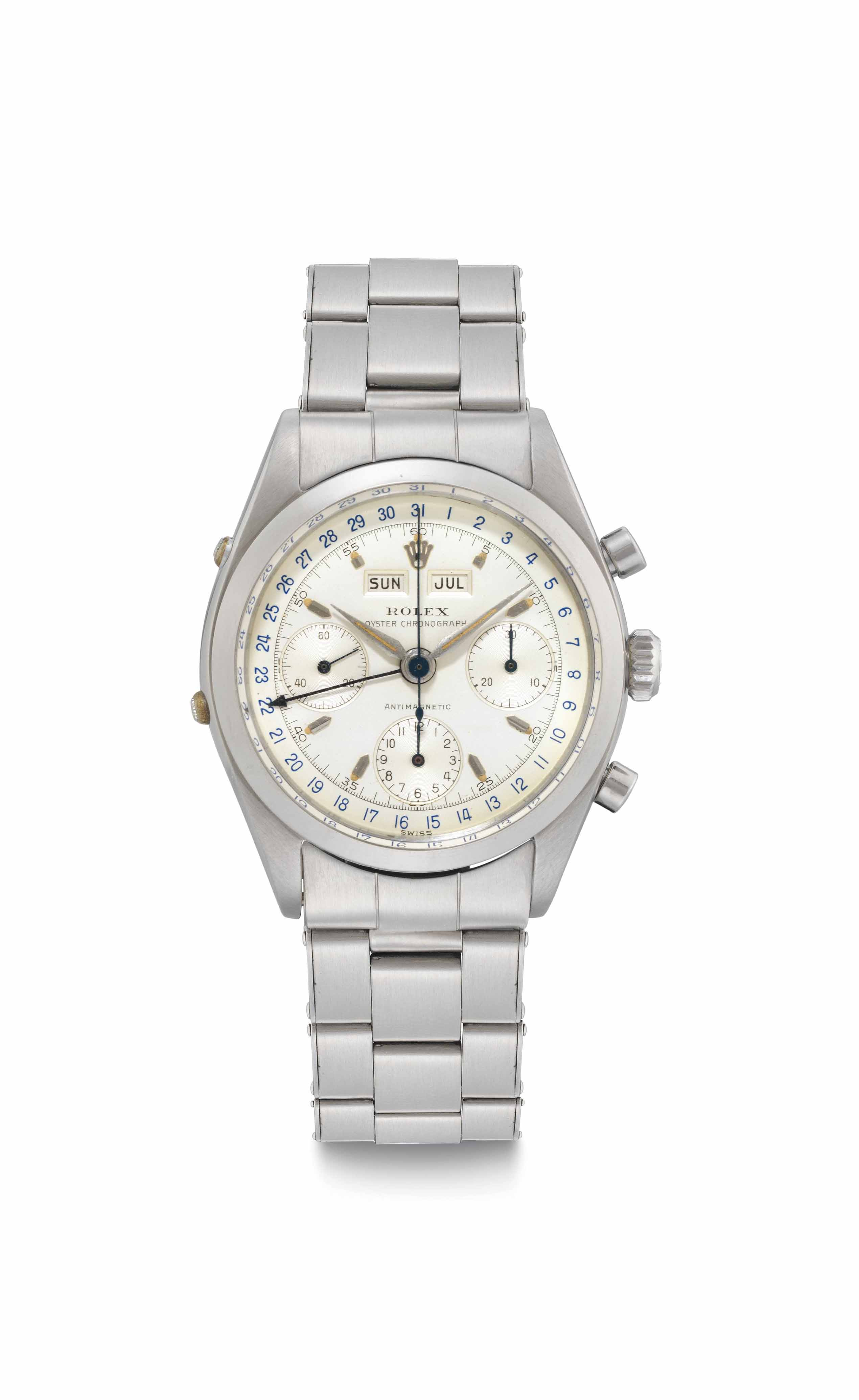 Rolex. A Fine and Rare Stainless Steel Triple Calendar Chronograph Wristwatch with Bracelet