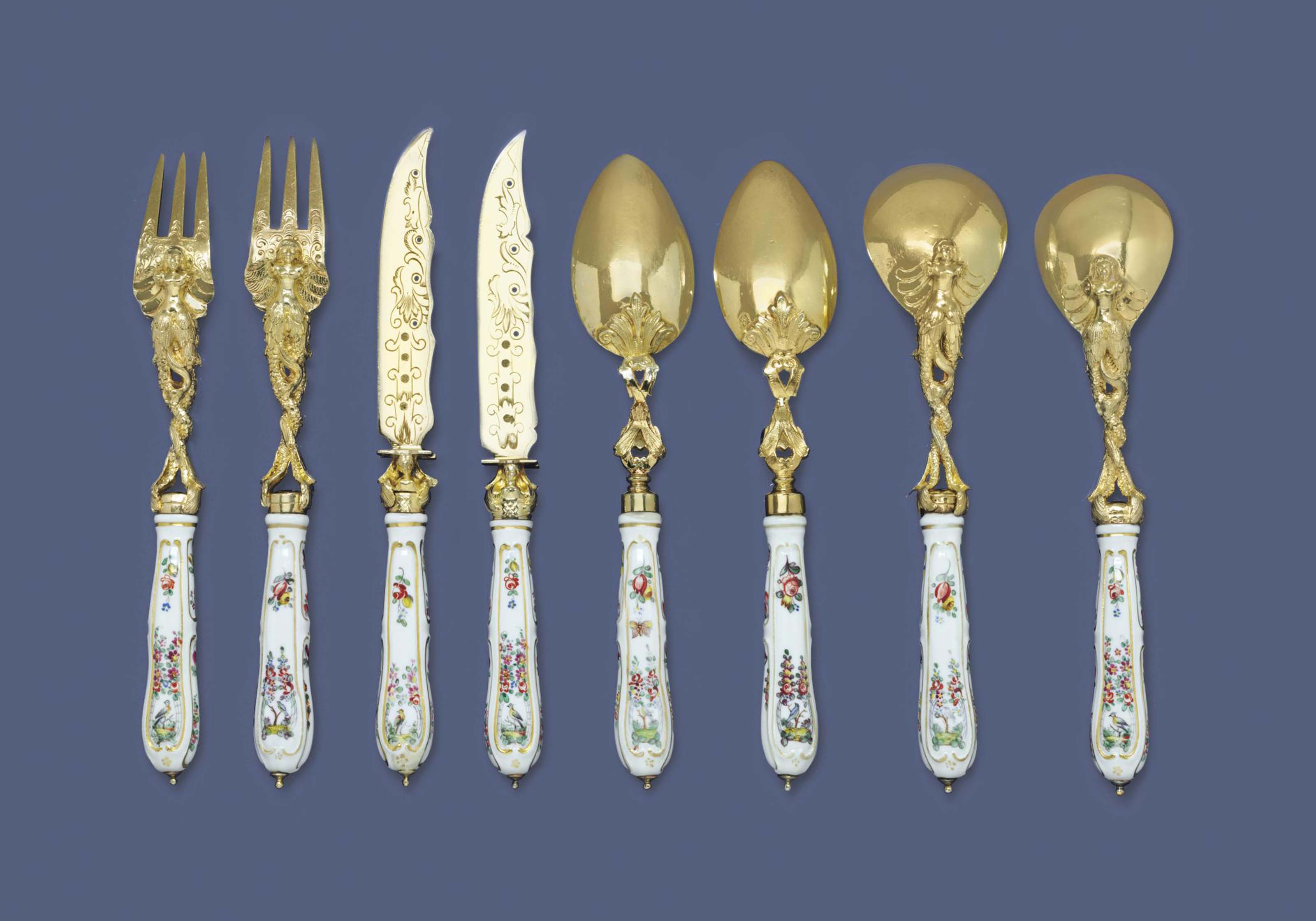 A CONTINENTAL SILVER-GILT AND PORCELAIN DESSERT SERVICE