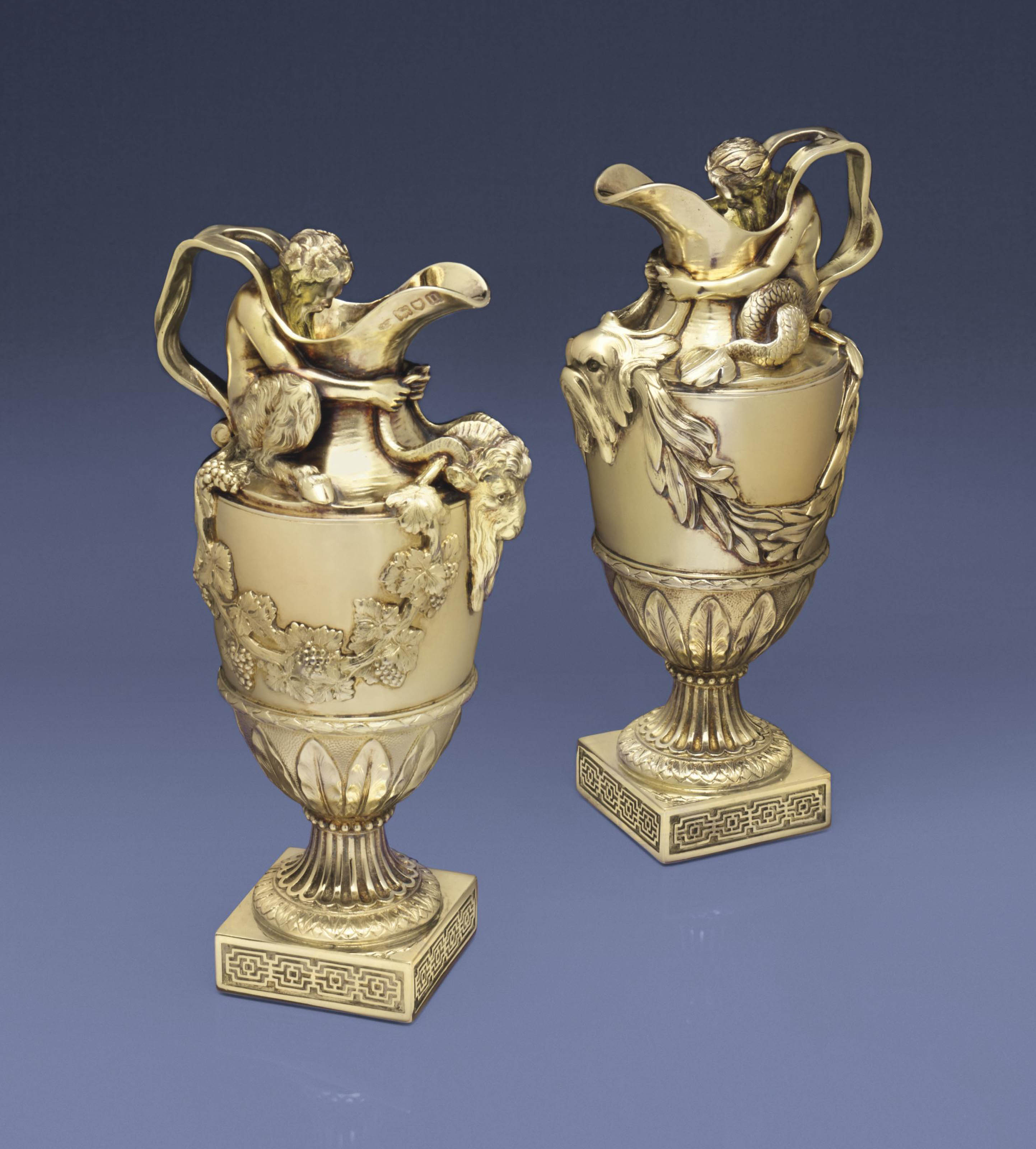 A PAIR OF EDWARD VII SILVER-GILT EWERS