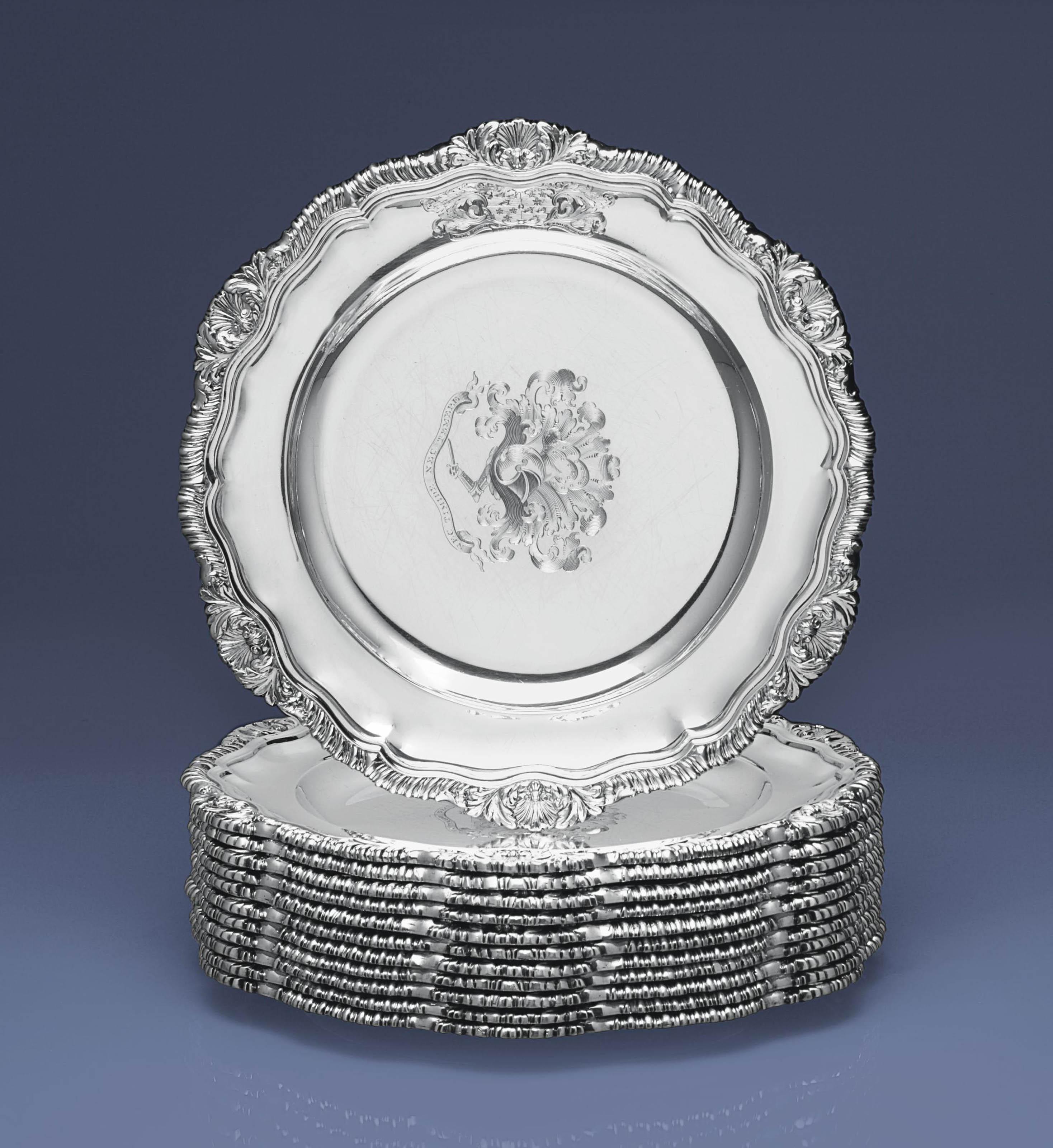 A SET OF TWELVE WILLIAM IV SILVER DINNER PLATES