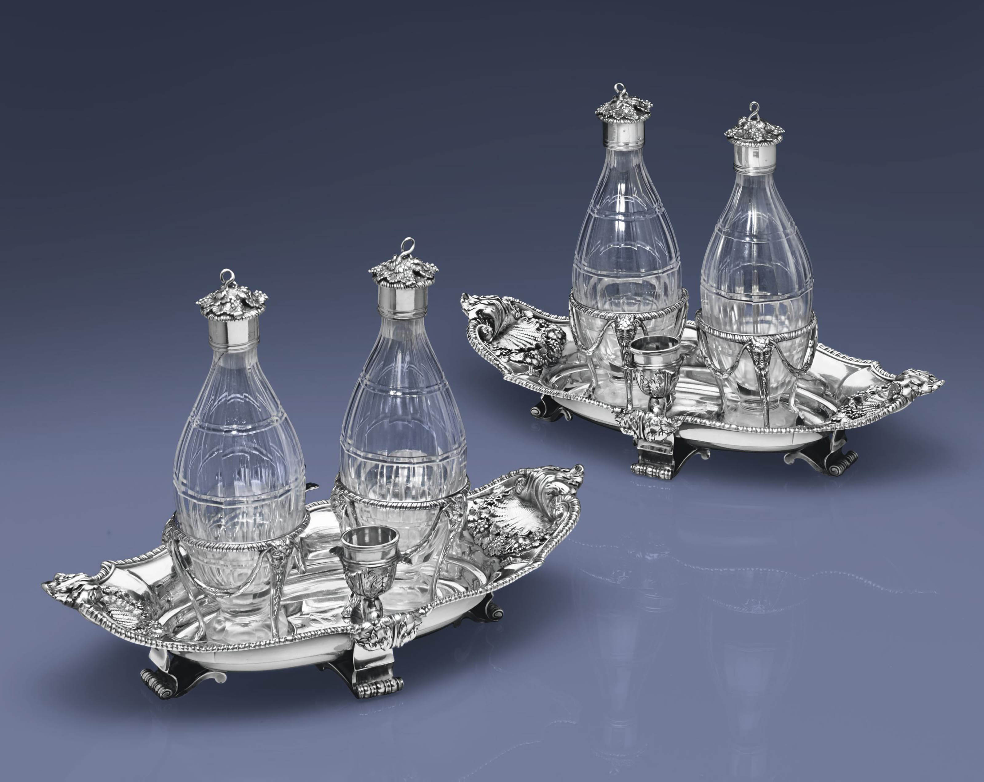 A PAIR OF GEORGE III SILVER TWO-BOTTLE CRUET STANDS