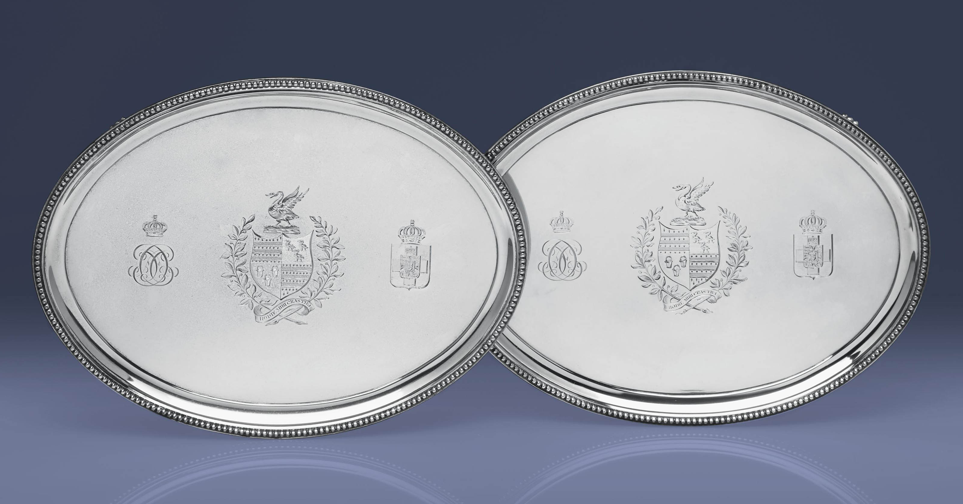A PAIR OF GEORGE III SILVER WAITERS