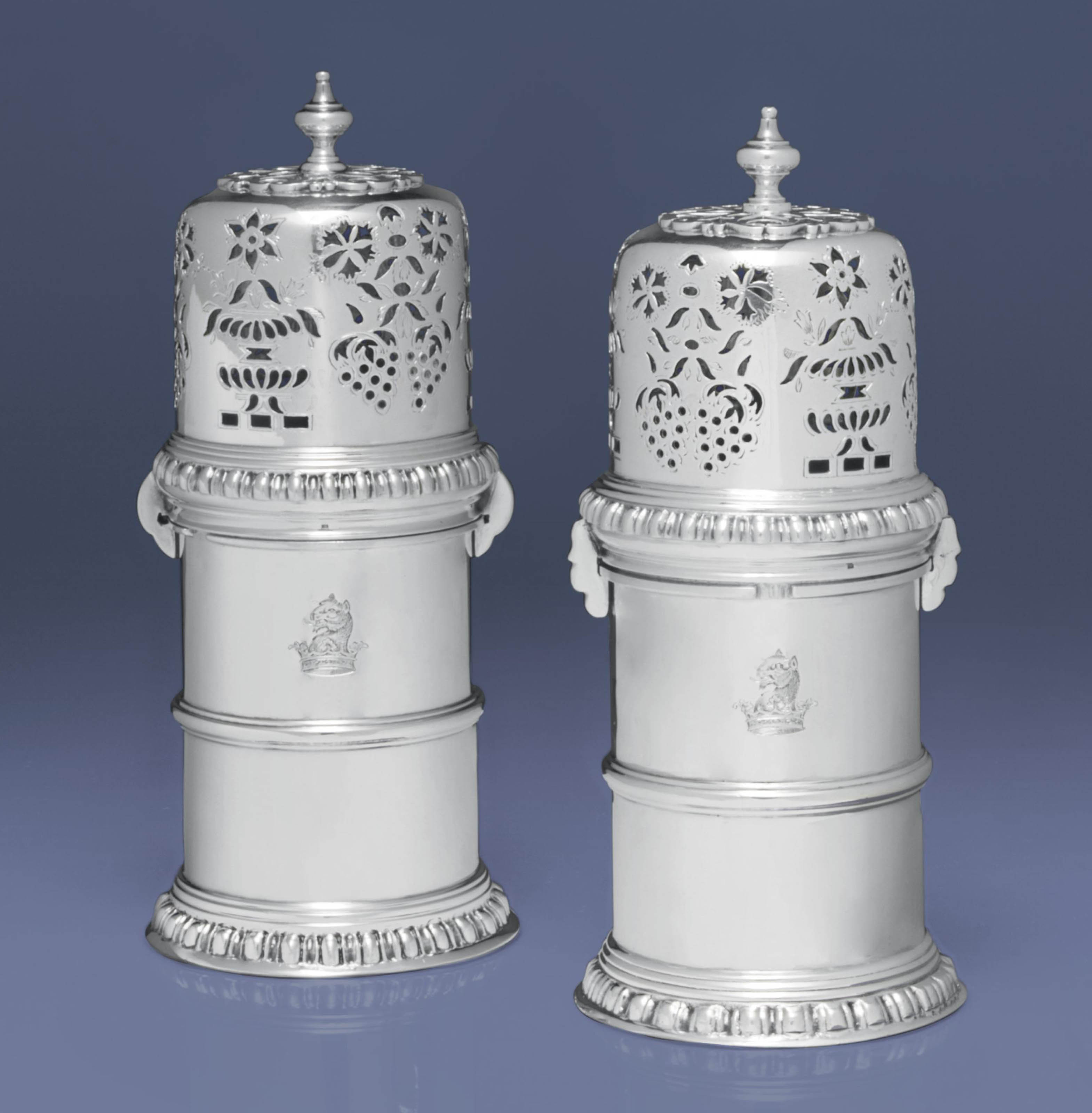A PAIR OF GEORGE V SILVER CASTERS