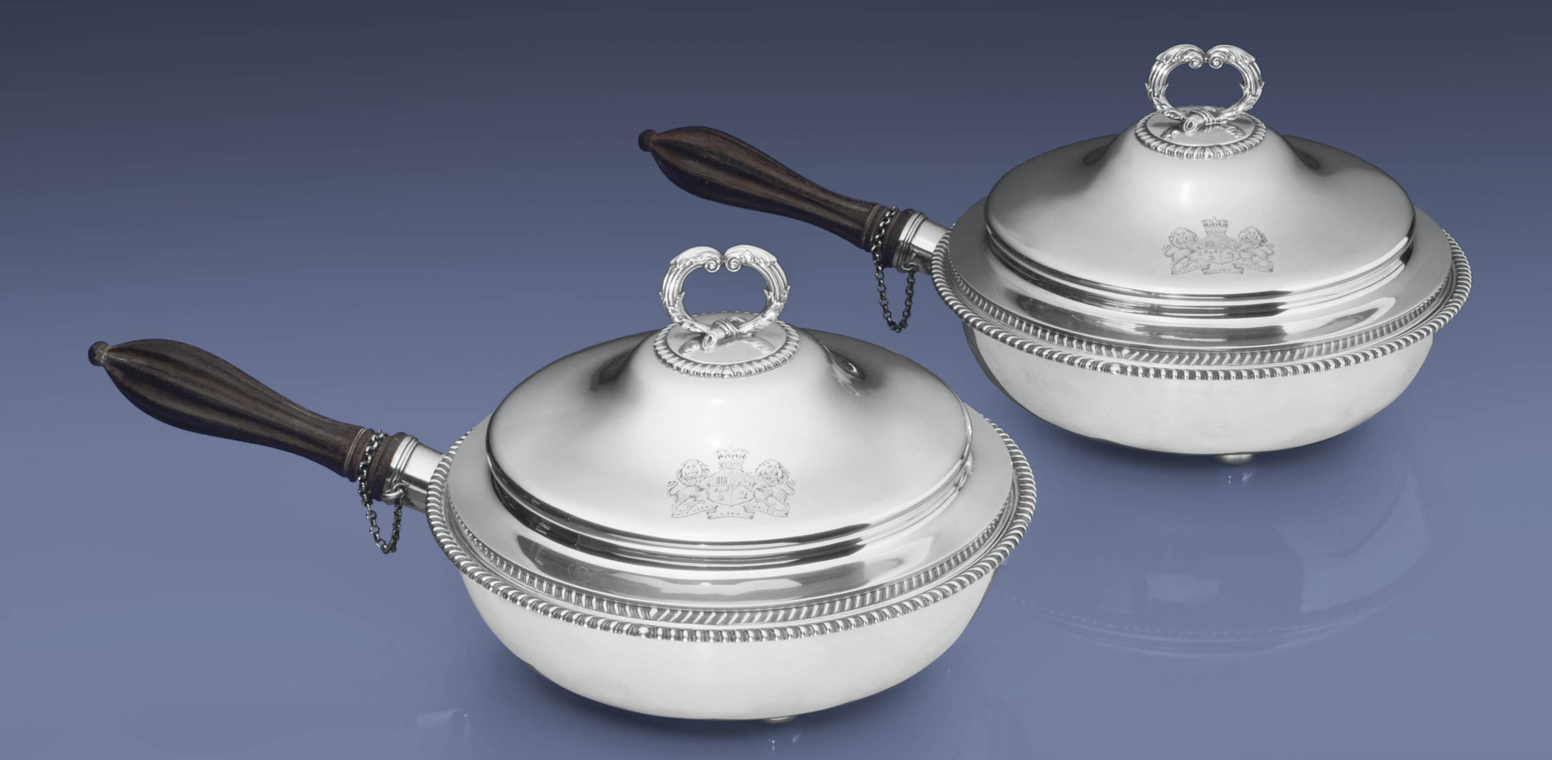 A PAIR OF VICTORIAN SILVER WARMING DISHES AND COVERS