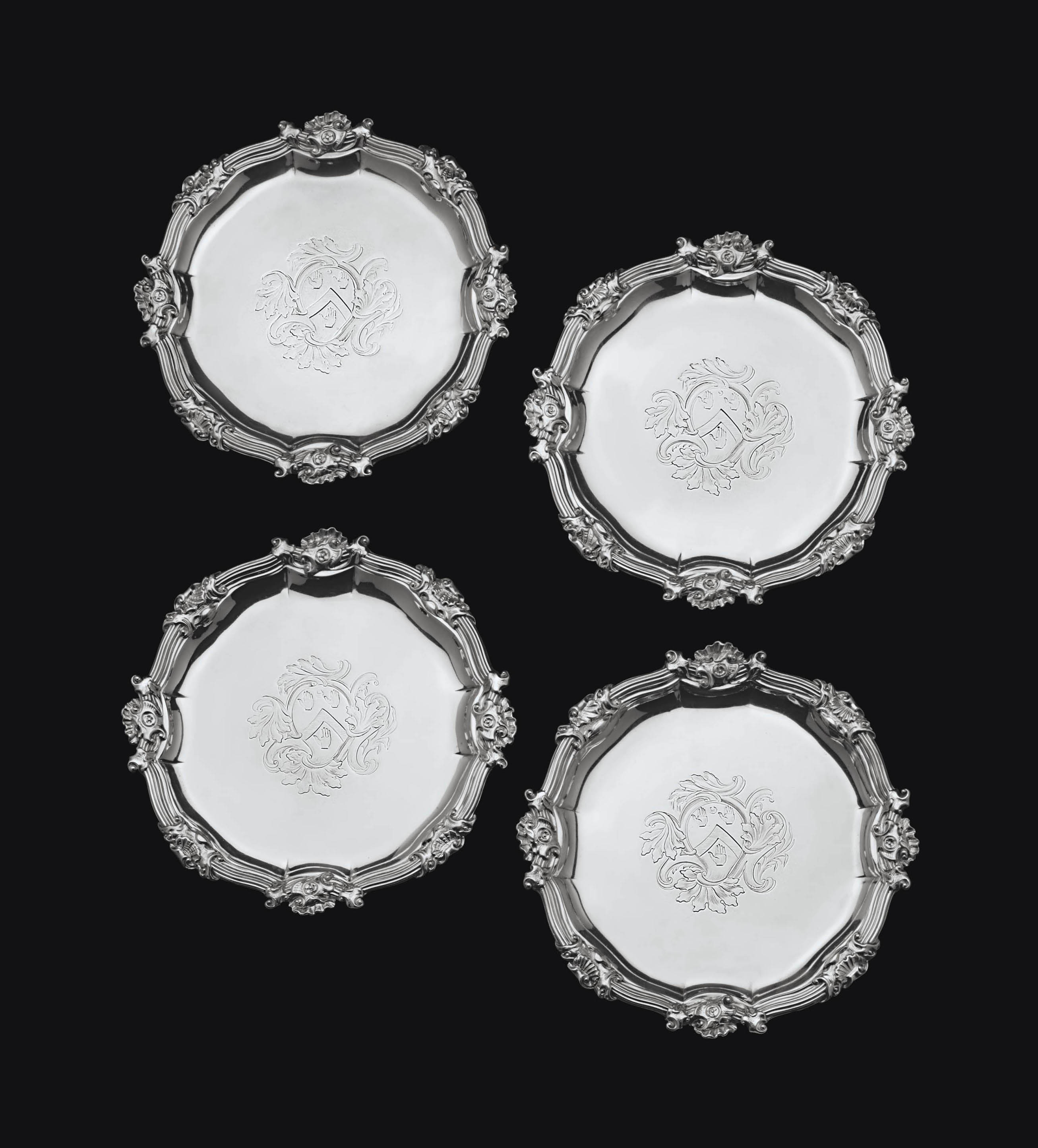 A SET OF FOUR GEORGE II SILVER WAITERS FROM THE MAYNARD SERVICE
