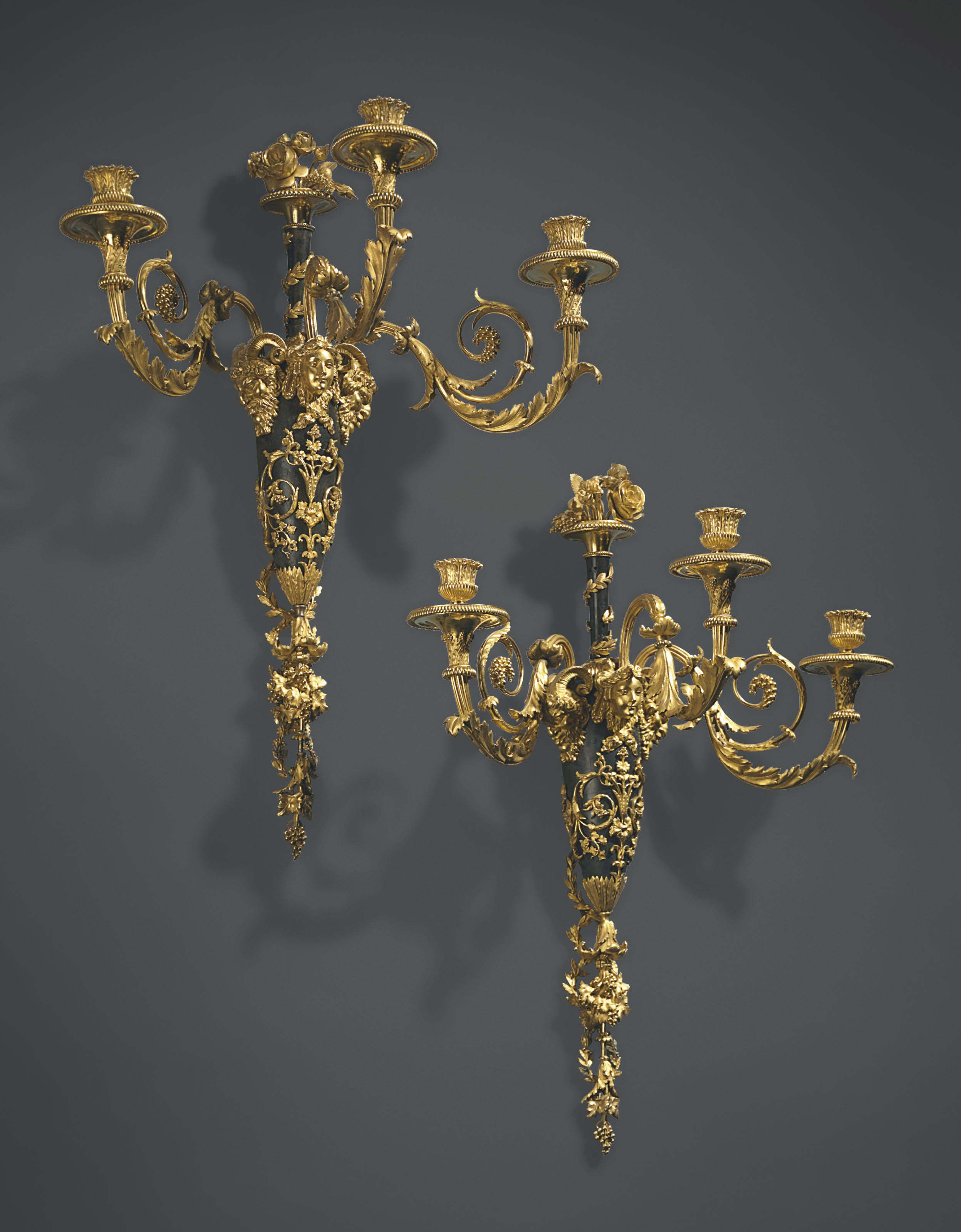 A PAIR OF LOUIS XVI ORMOLU AND PATINATED BRONZE THREE-BRANCH WALL-LIGHTS