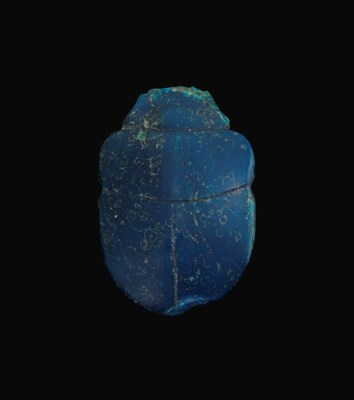 A LARGE EGYPTIAN GLASS SCARAB