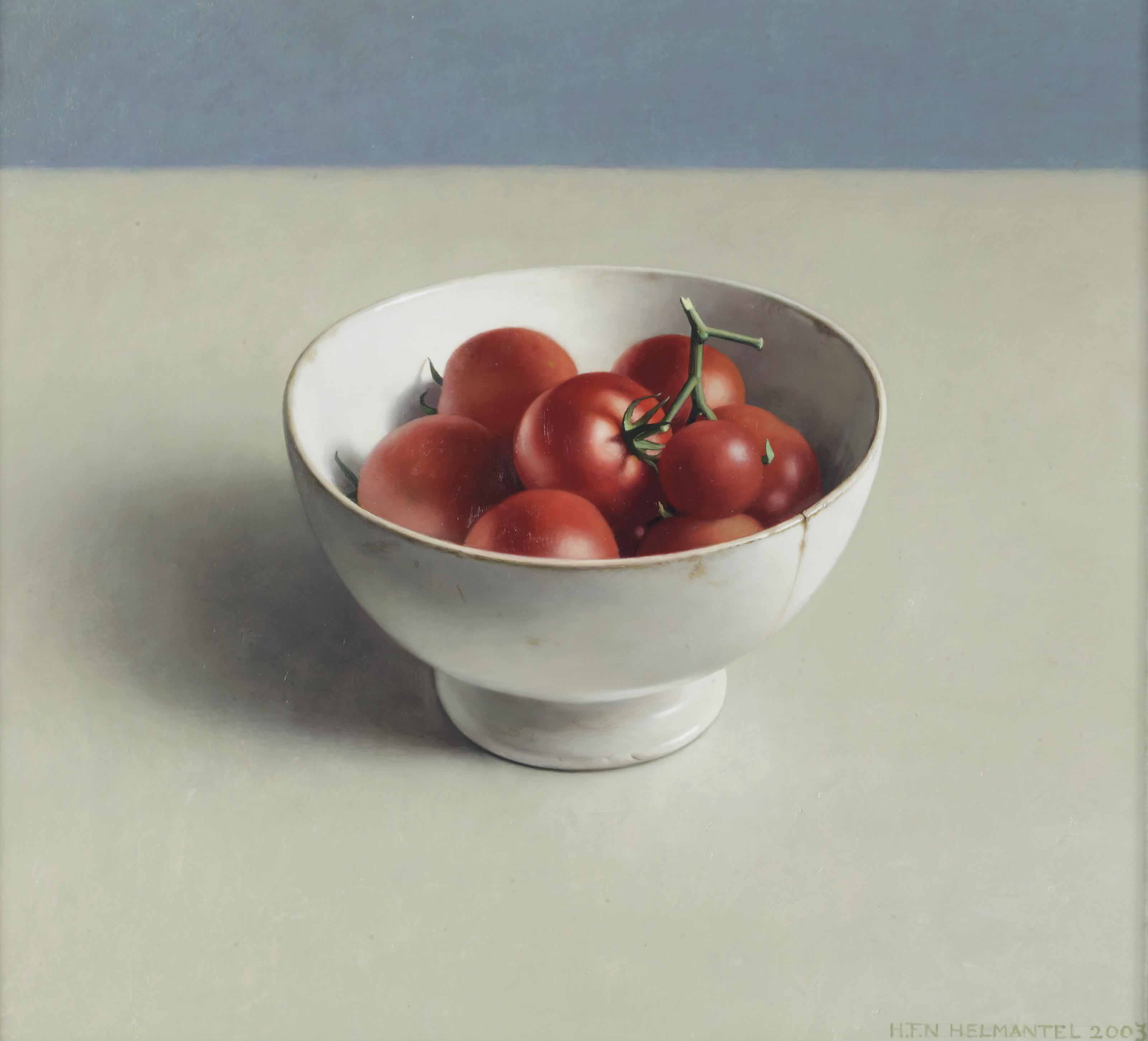A still life with tomatoes in a bowl