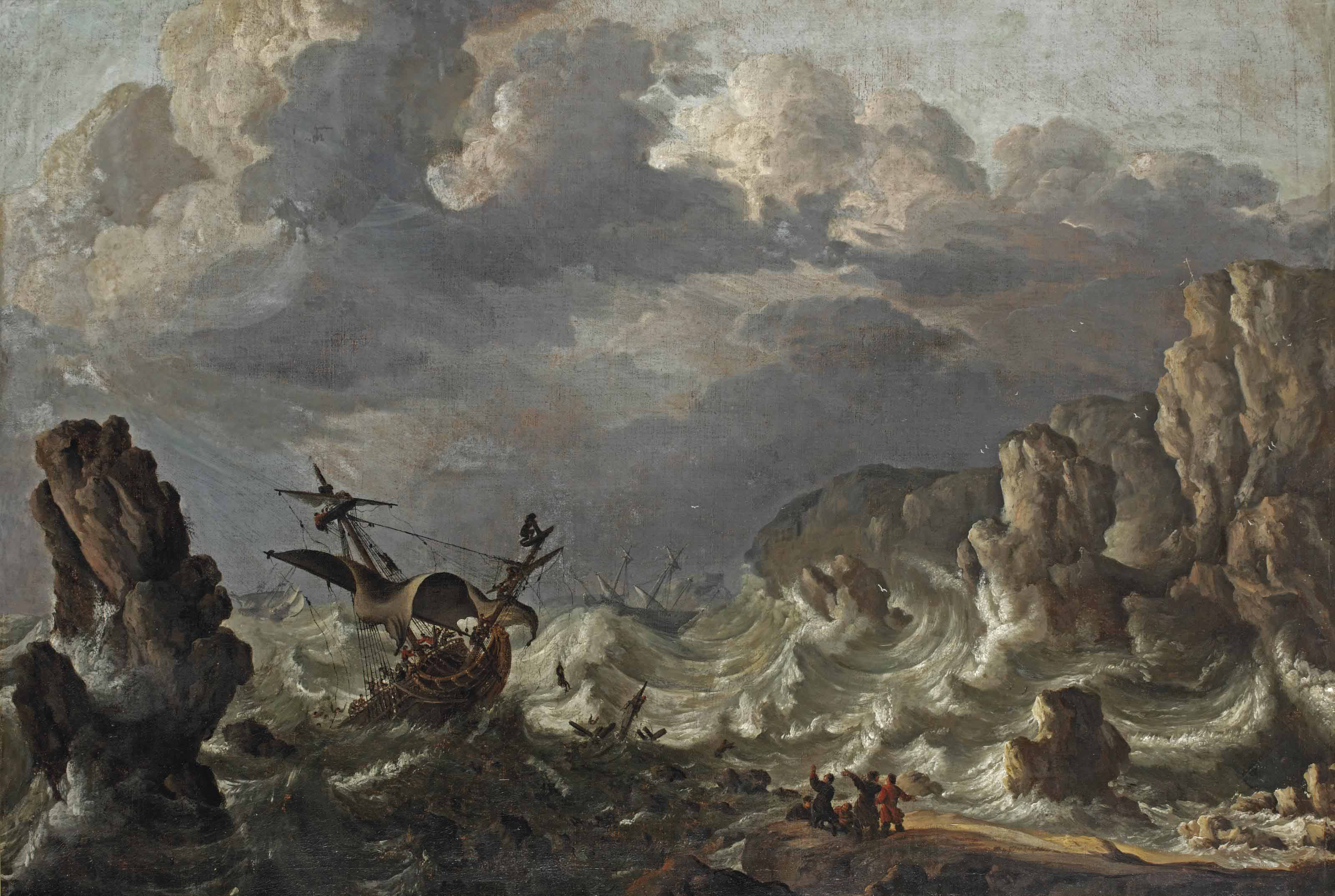 A ship wreck near a rocky coast in rough seas