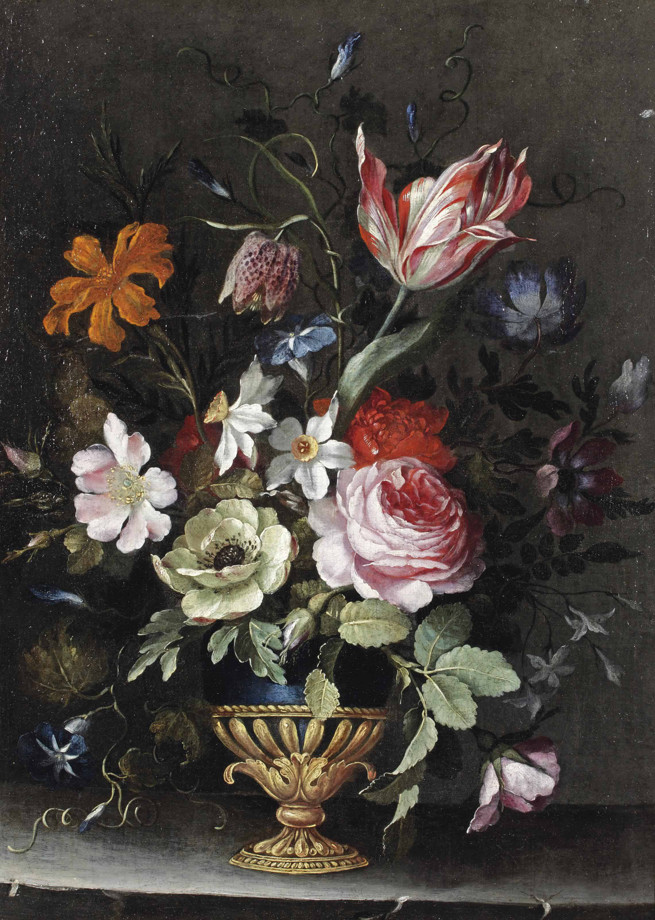 Roses, peonies, a tulip, daffodils, morning glory and other flowers in a blue lacquer and gilt vase on a stone ledge