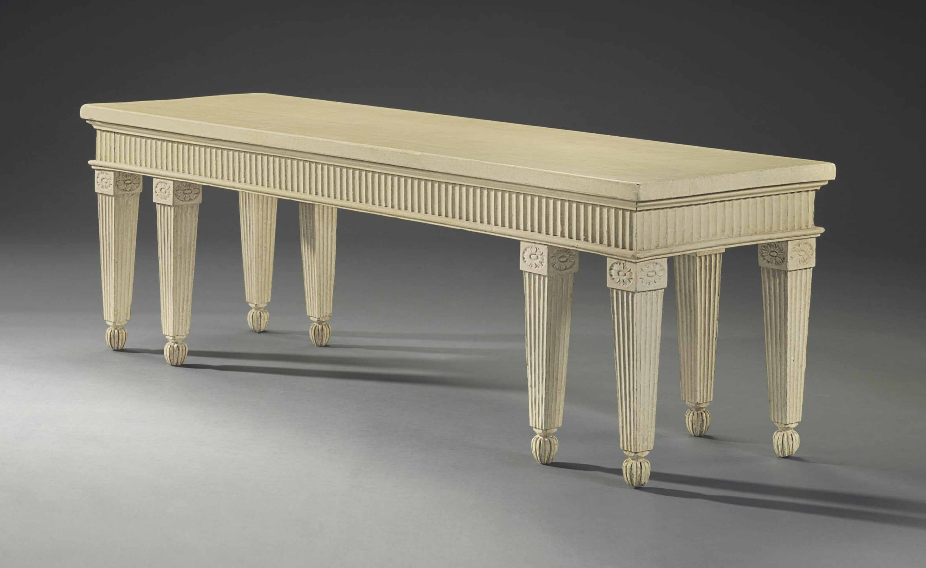 A GEORGE III CREAM-PAINTED HALL BENCH